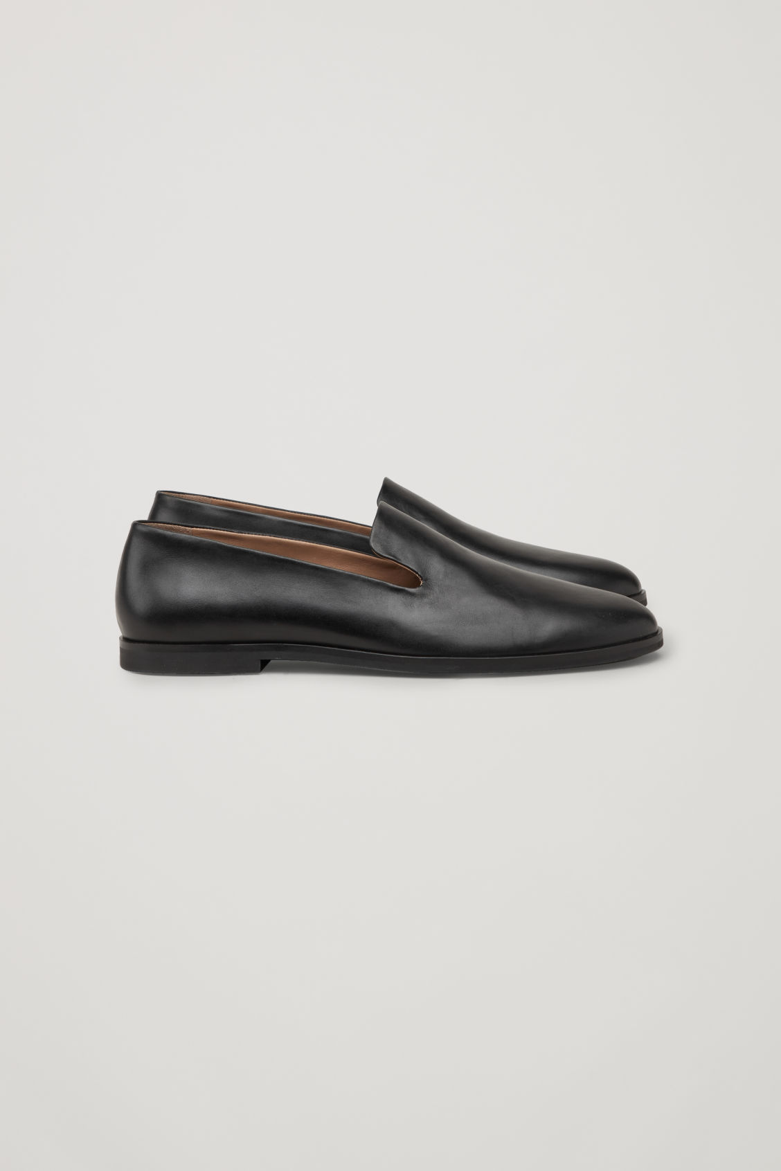 Side image of Cos leather slip-on shoes in black