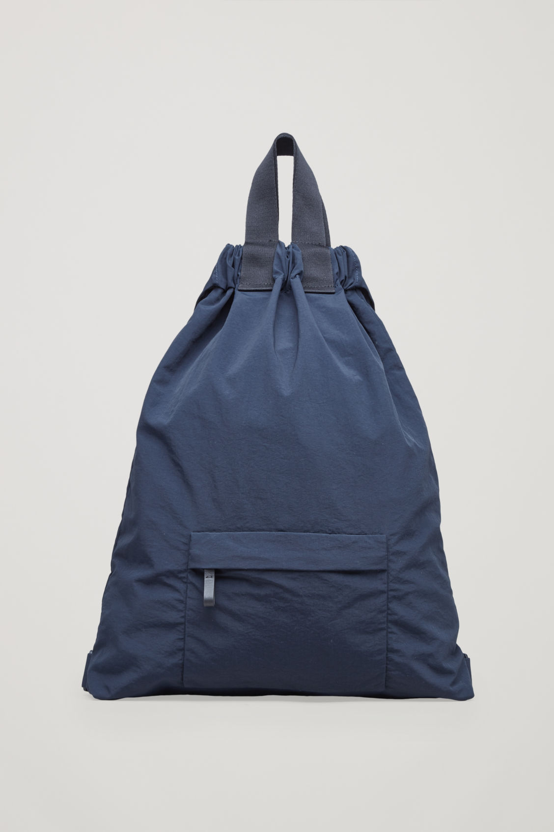 Front image of Cos technical drawstring backpack  in blue