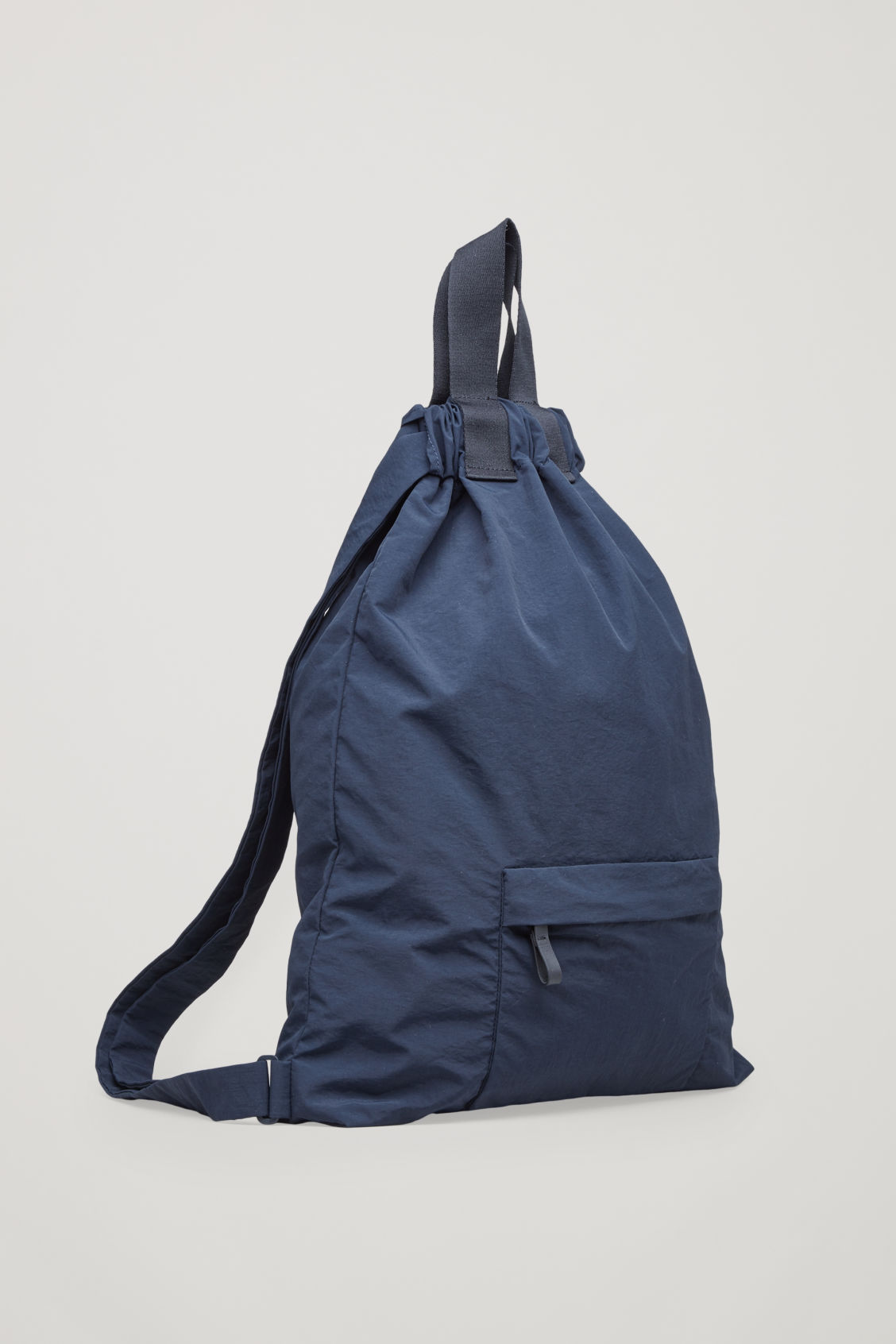 Side image of Cos technical drawstring backpack  in blue