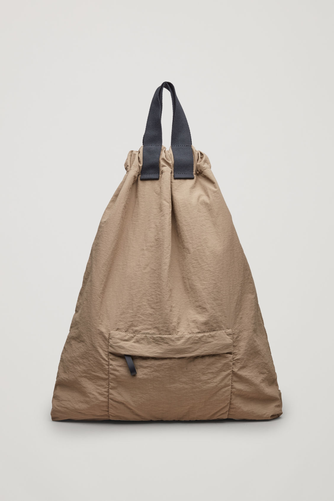 Front image of Cos technical drawstring backpack  in beige