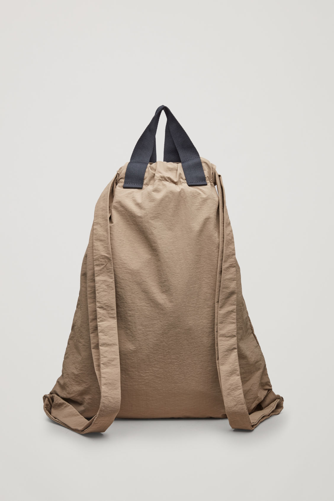 Side image of Cos technical drawstring backpack  in beige