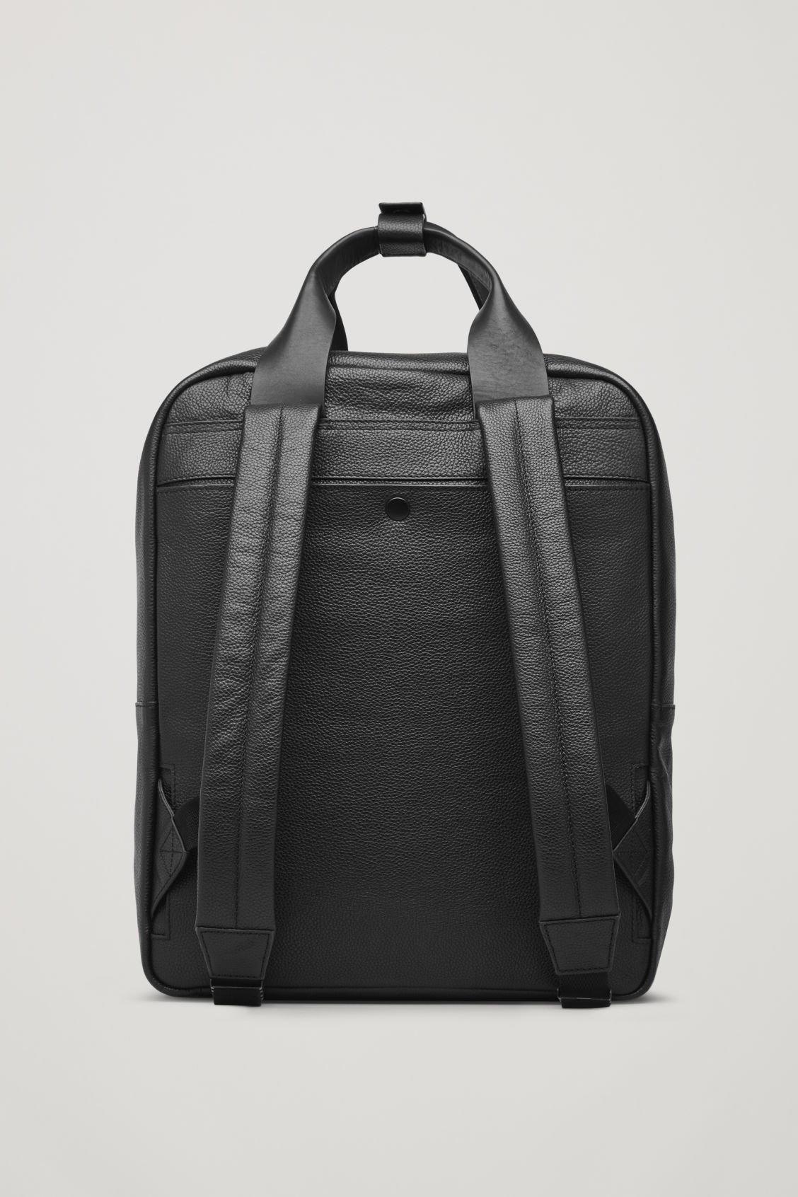 Side image of Cos grained leather backpack  in black
