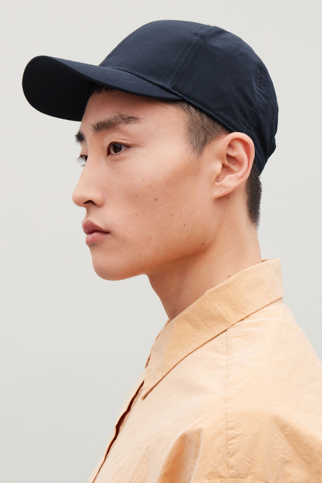 Side image of Cos baseball cap in blue