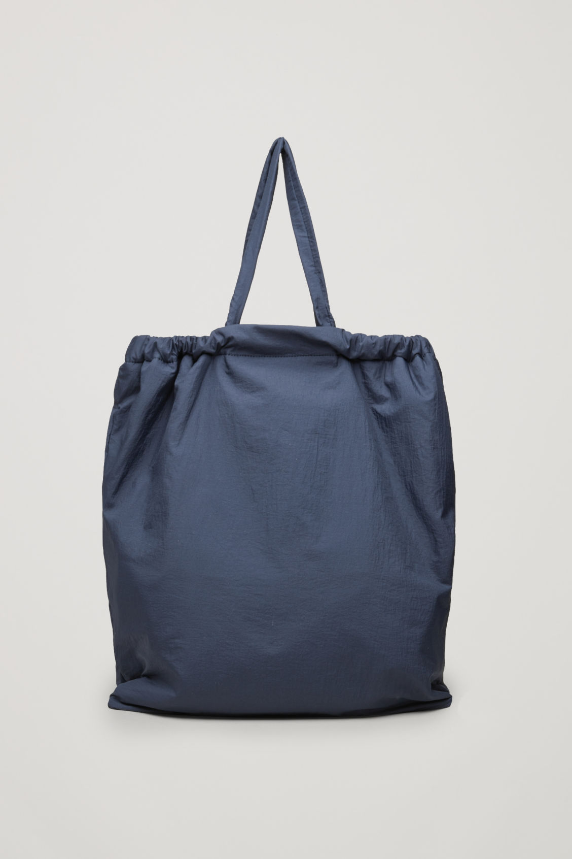 Side image of Cos gathered tote bag  in blue
