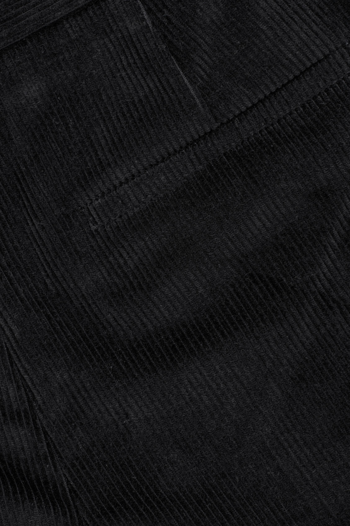 Side image of Cos tapered corduroy trousers in black