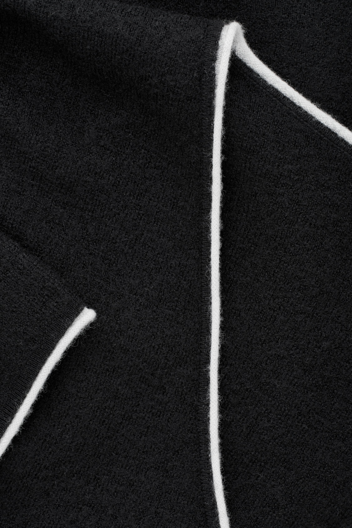 Side image of Cos merino jumper with contrast edge in black