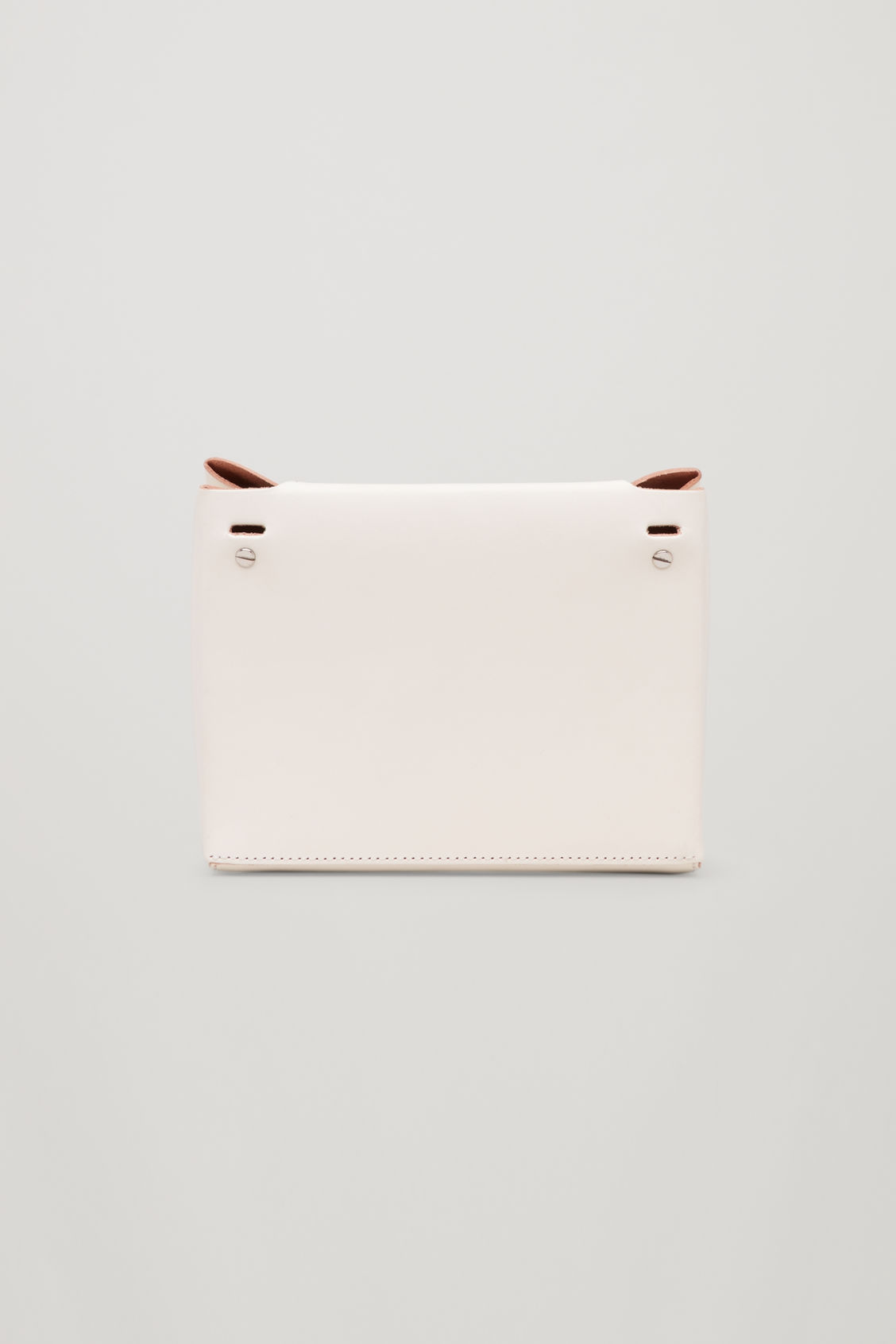 Side image of Cos structured leather bag  in white