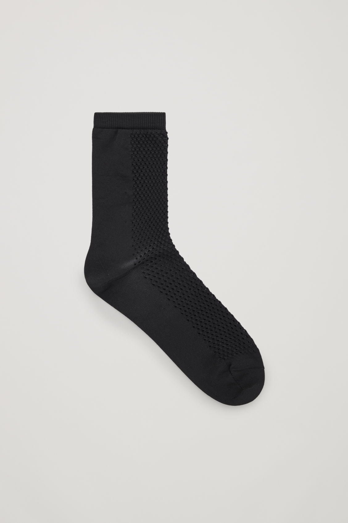 Front image of Cos crochet patterned ankle socks in black