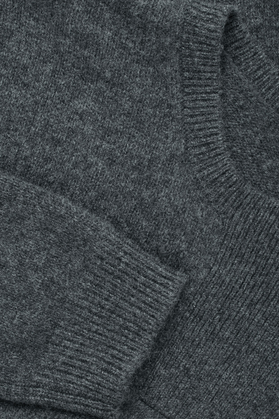 Side image of Cos cashmere jumper with rectangle stitches in grey
