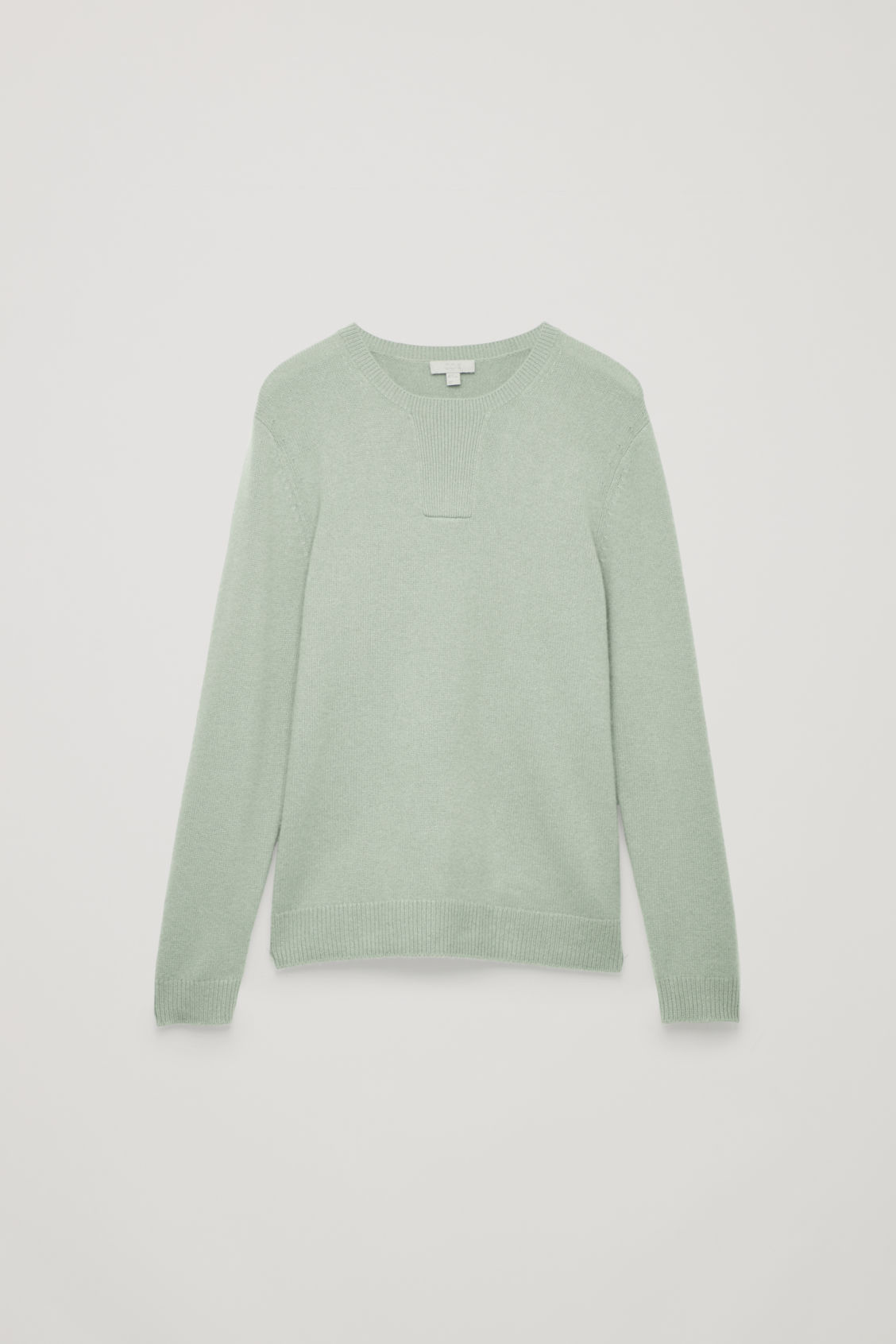 Front image of Cos cashmere jumper with rectangle stitches in green