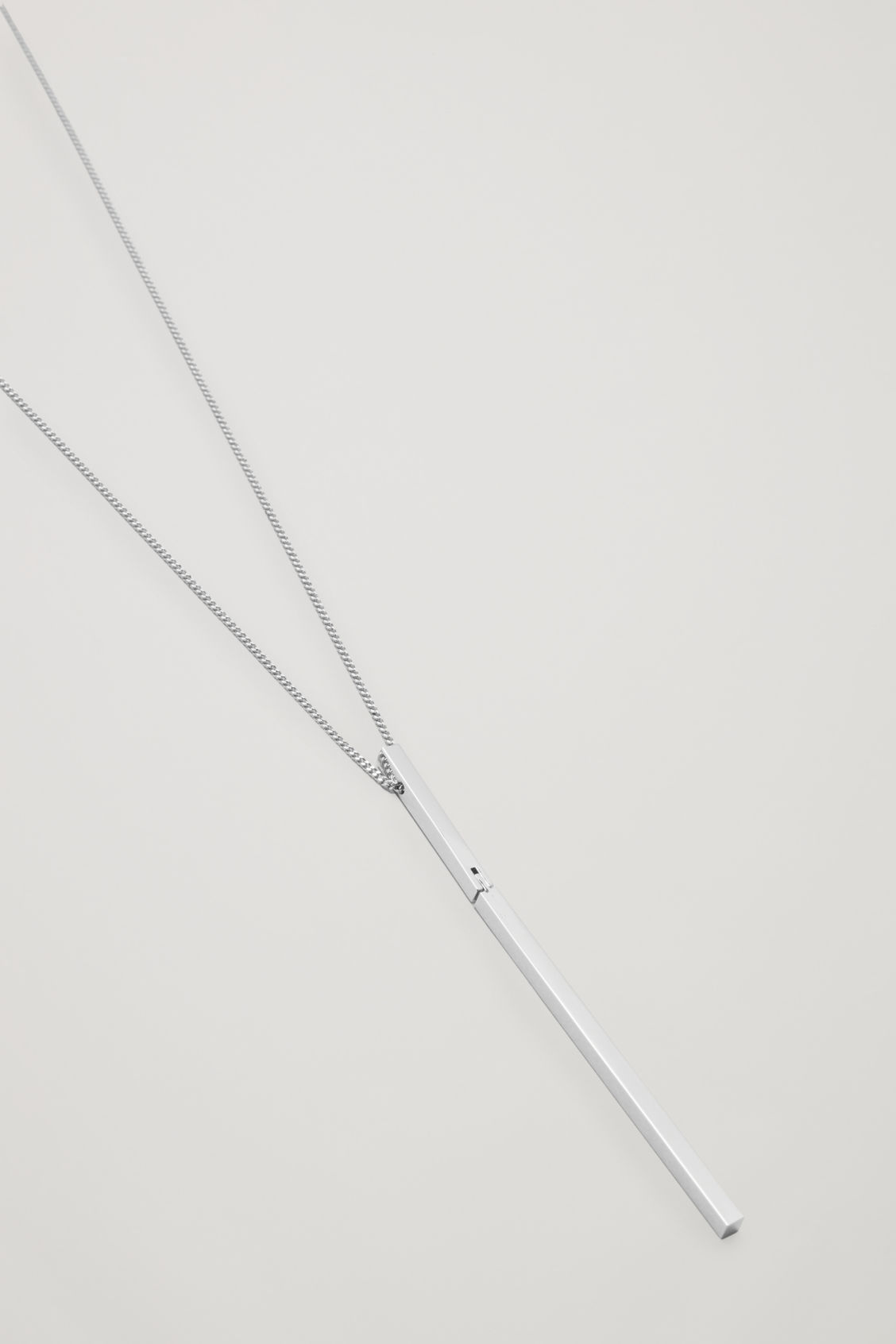Side image of Cos long necklace with movable pendant in silver