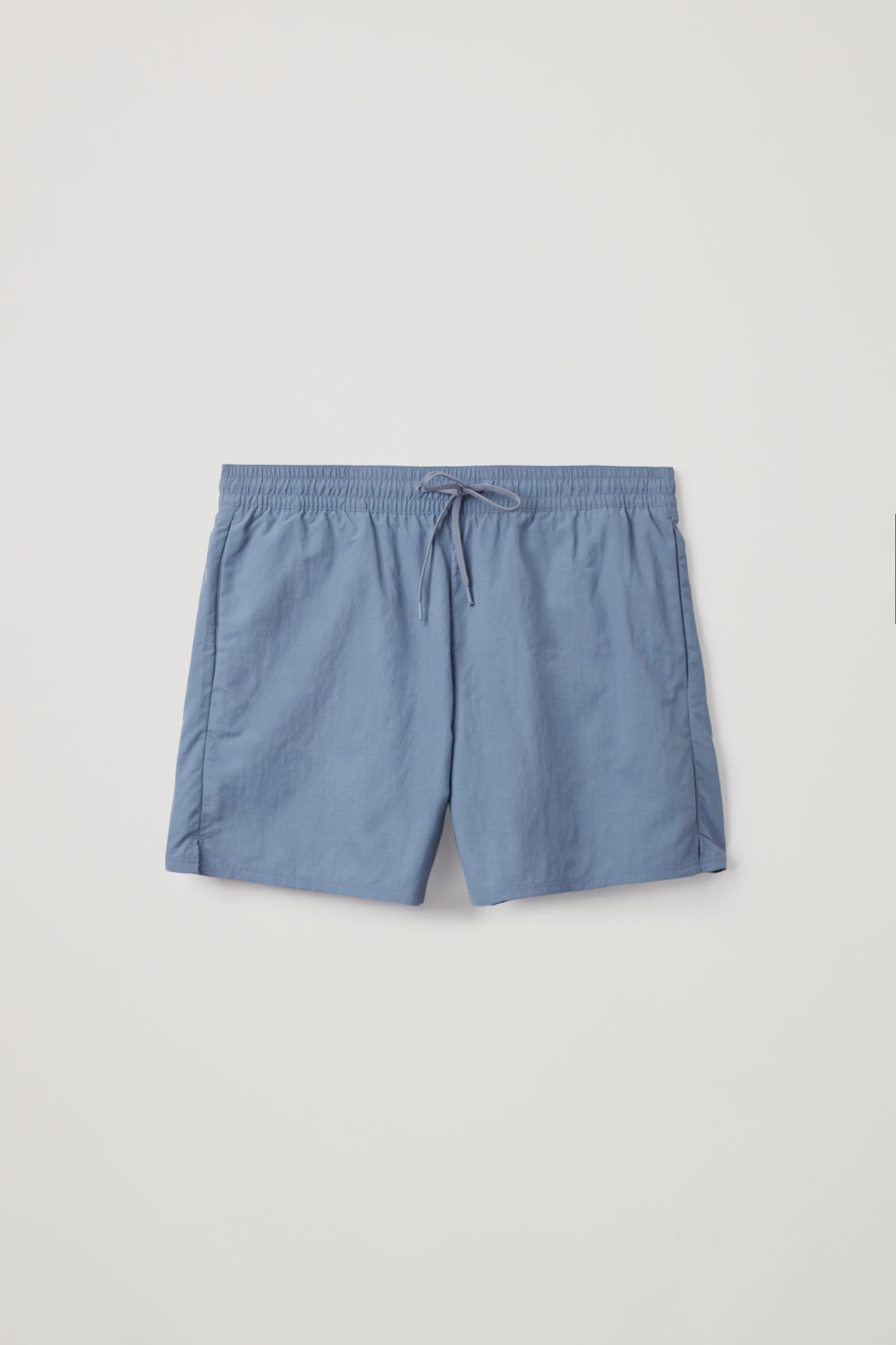 Front image of Cos swim shorts in blue