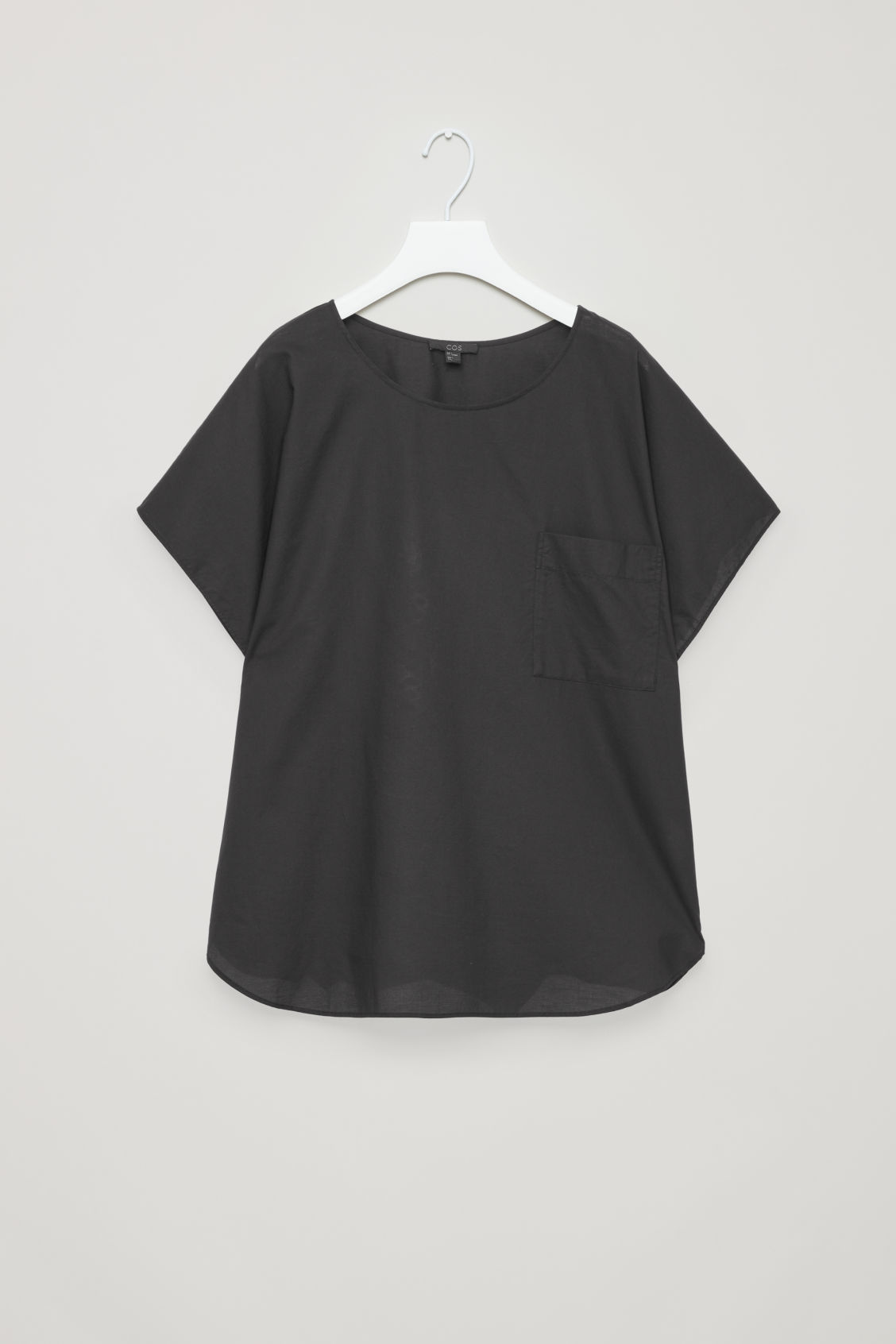 Front image of Cos oversized cotton top in black