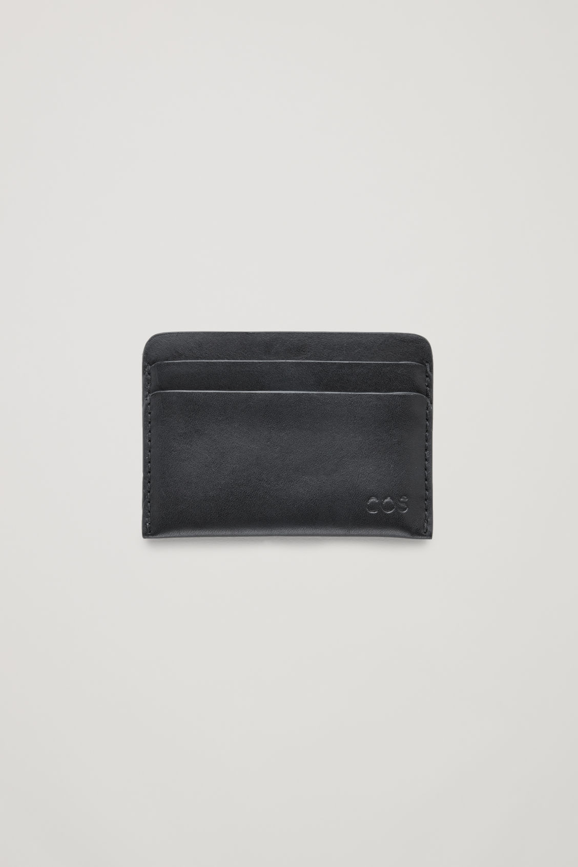 Front image of Cos round-edged leather cardholder  in black