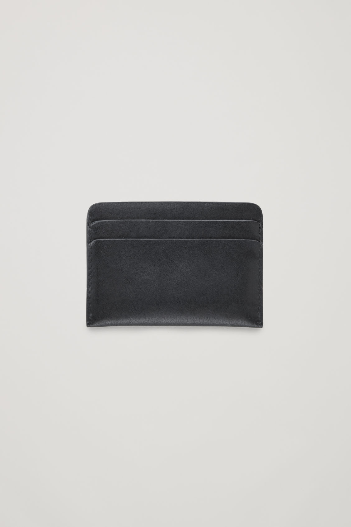Side image of Cos round-edged leather cardholder  in black
