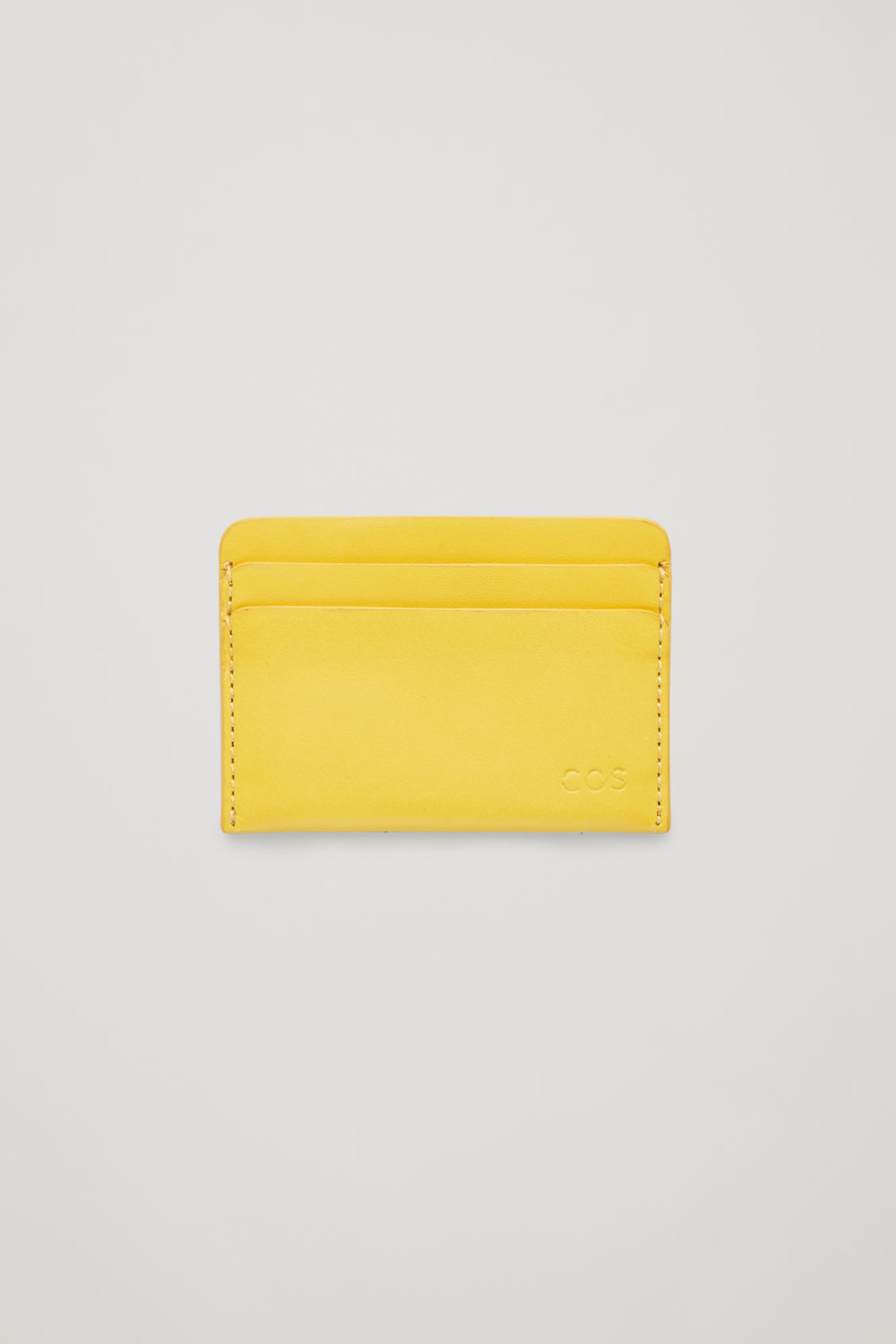 Front image of Cos round-edged leather cardholder  in yellow