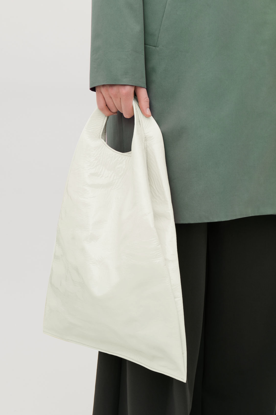 Side image of Cos patent leather tote bag  in white