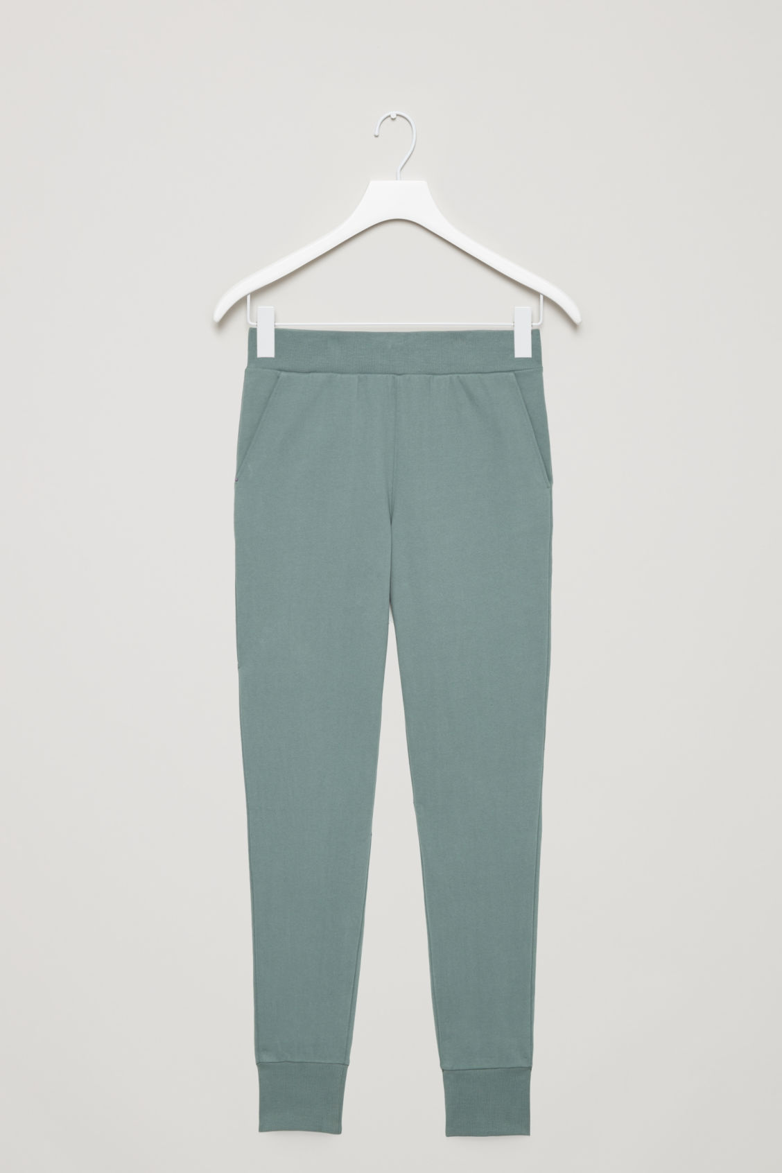 Front image of Cos relaxed jersey trousers  in green