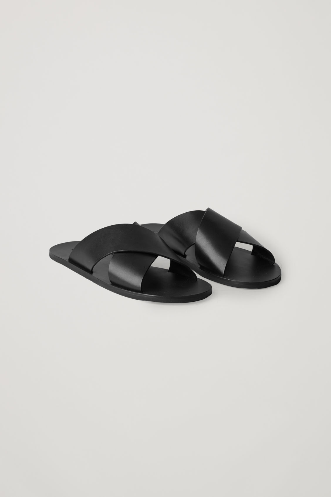 Front image of Cos crossover leather sandals in black