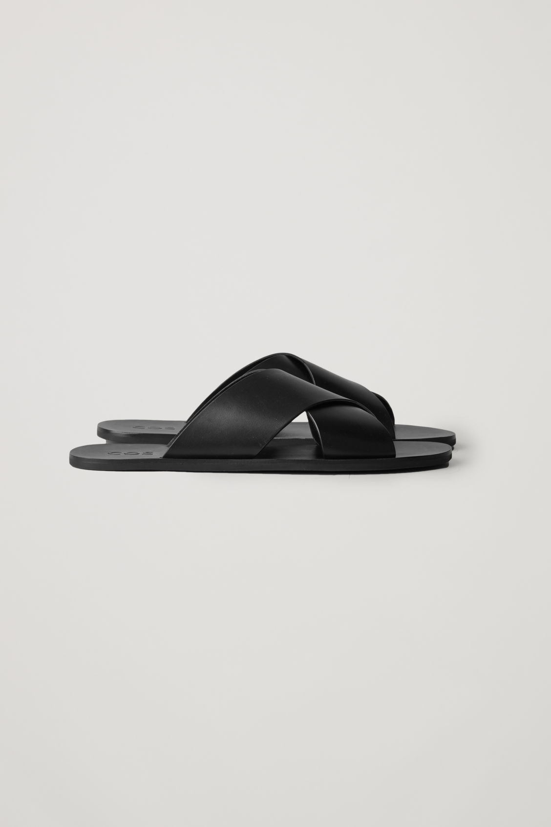 Side image of Cos crossover leather sandals in black