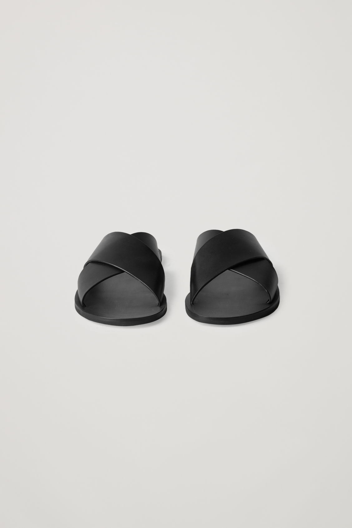 Side image of Cos leather slip-on sandals in black