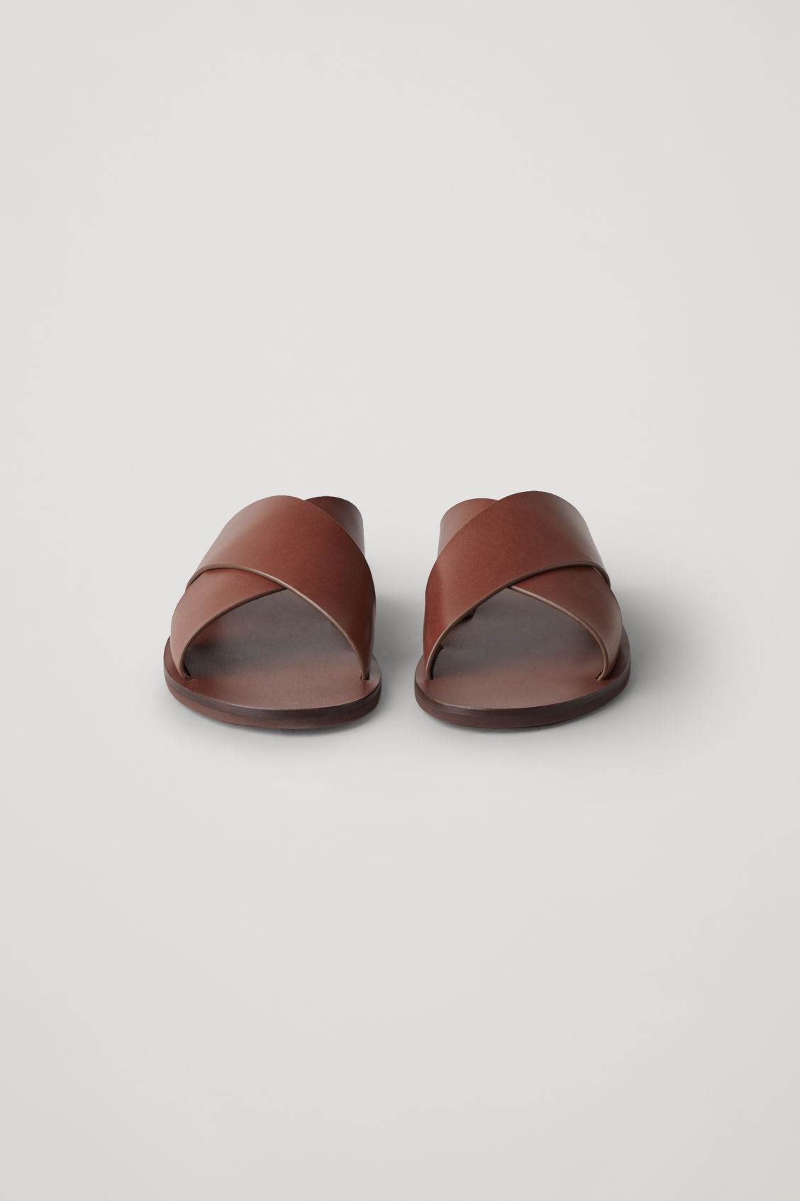 Side image of Cos leather slip-on sandals in brown