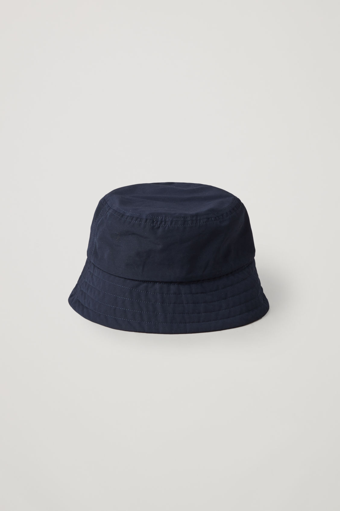 Side image of Cos bucket hat in blue