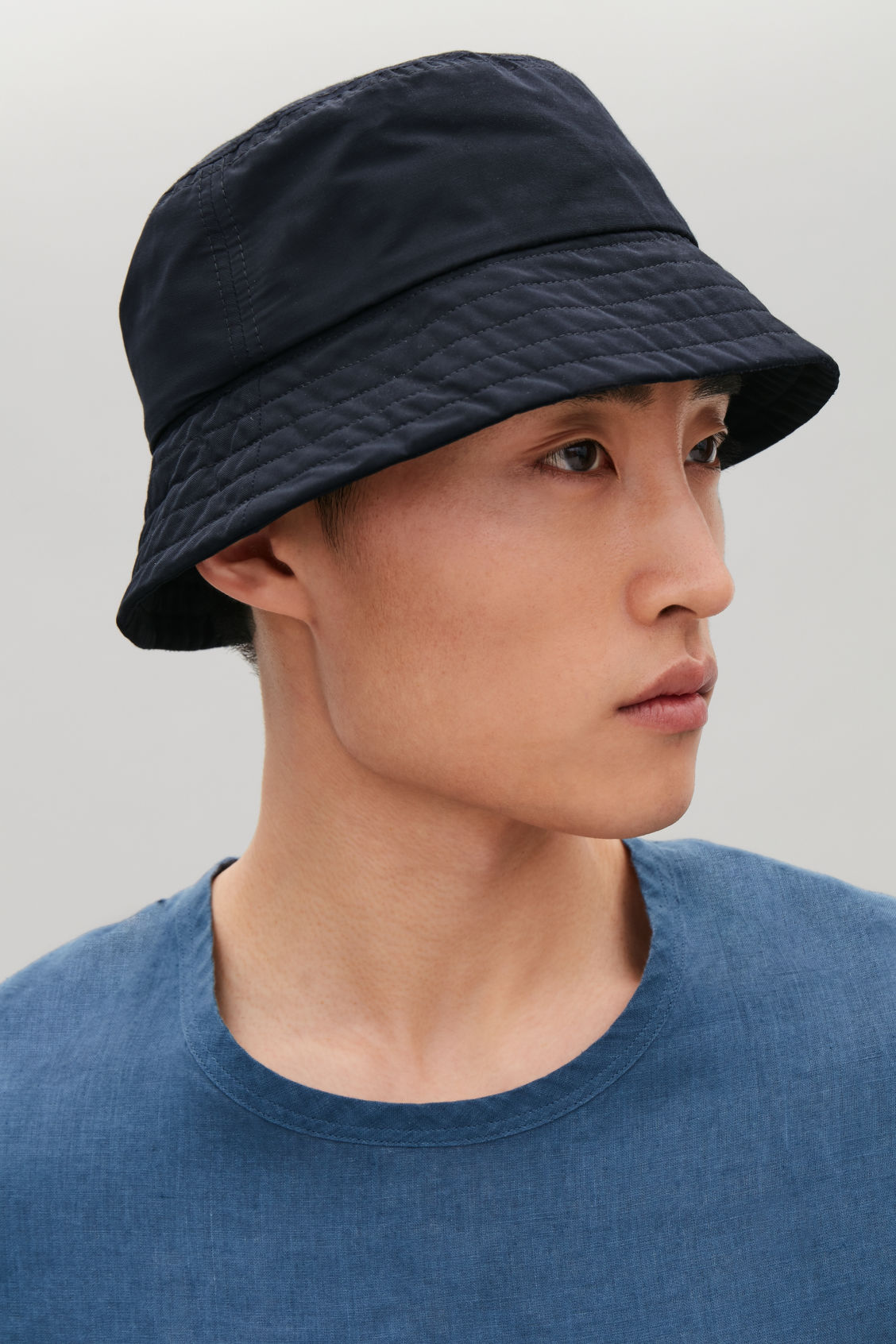Side image of Cos bucket hat in blue 7abe4698065