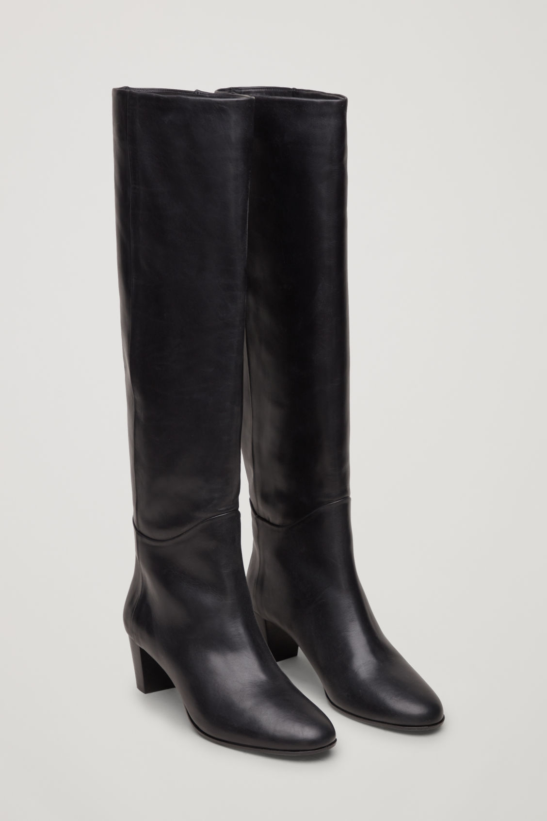 Front image of Cos knee-high leather boots in black