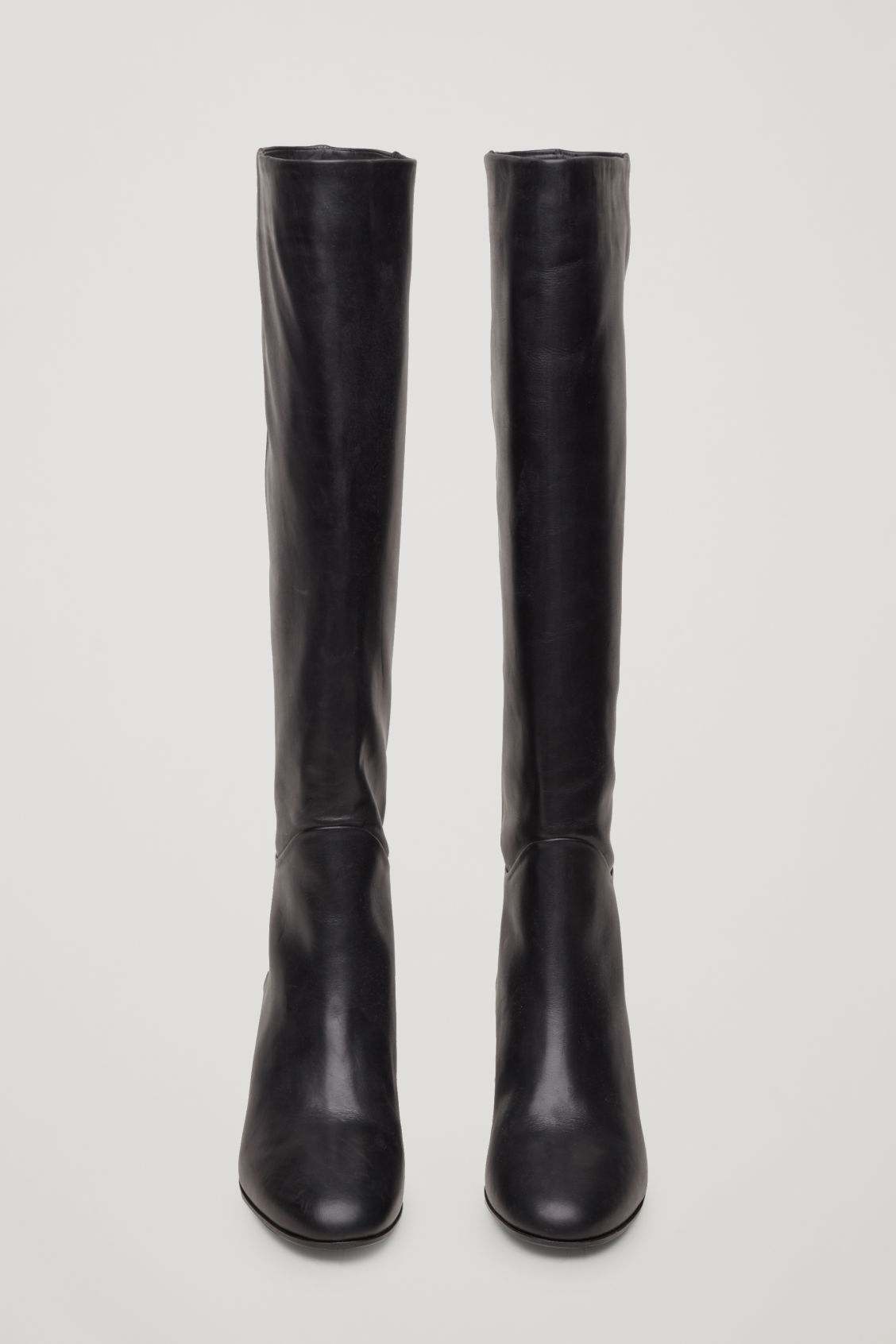 Side image of Cos knee-high leather boots in black