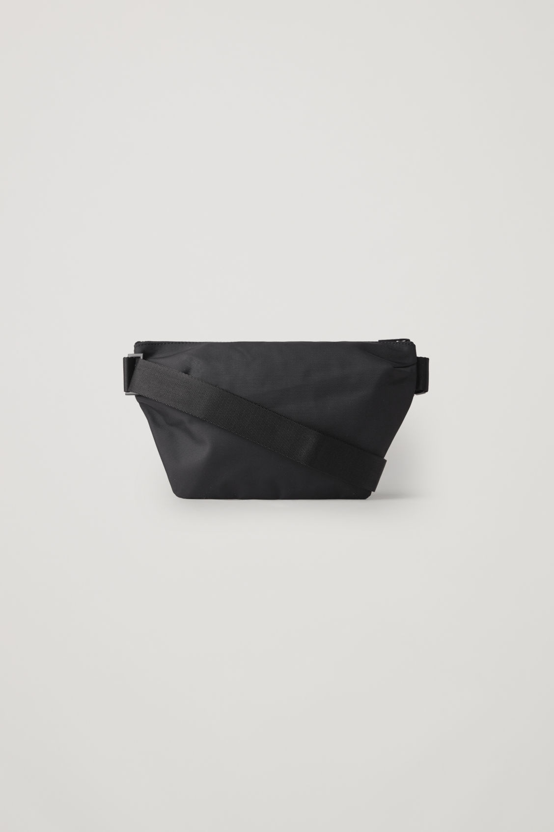 Front image of Cos zip-up belt bag  in black