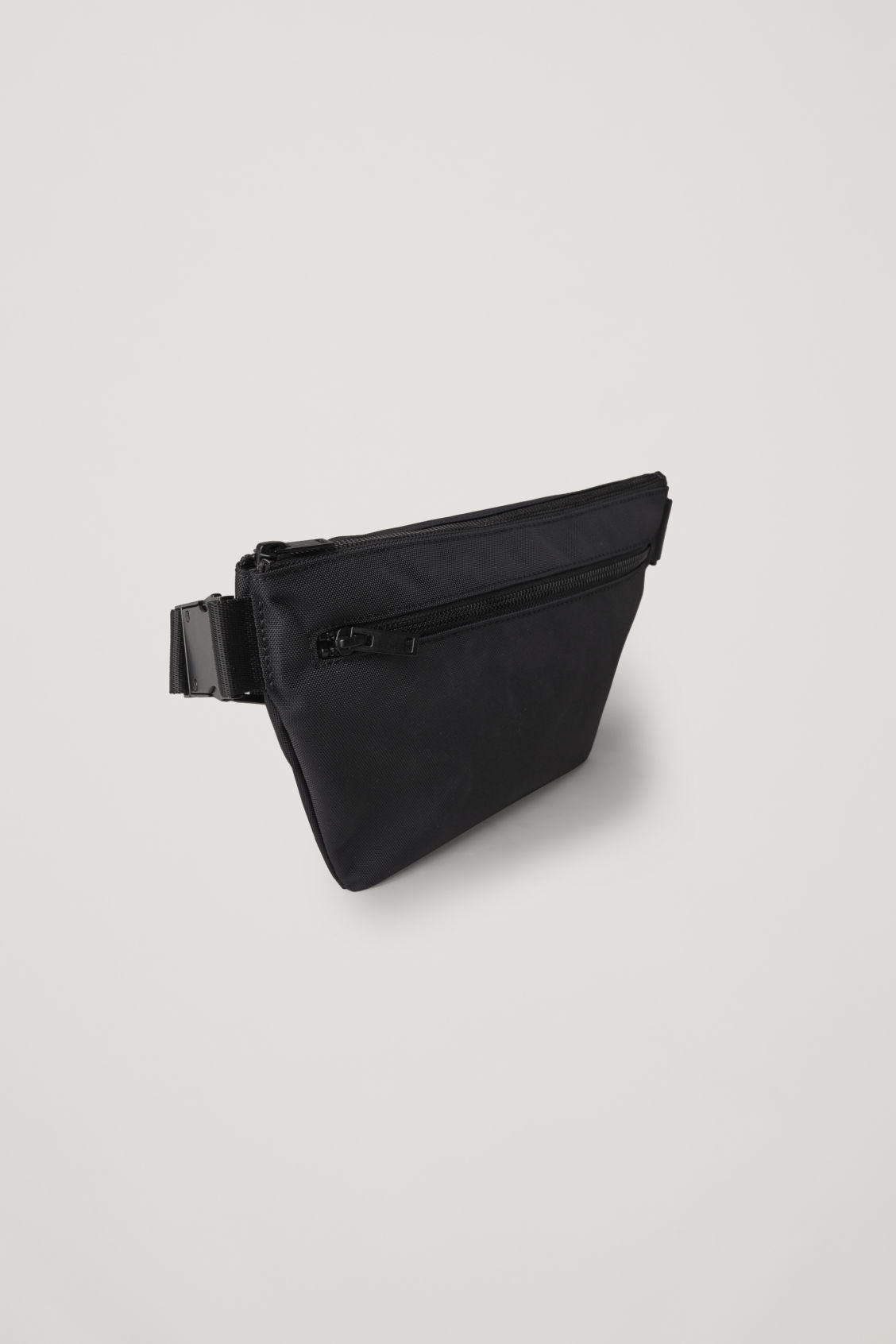 Side image of Cos zip-up belt bag  in black