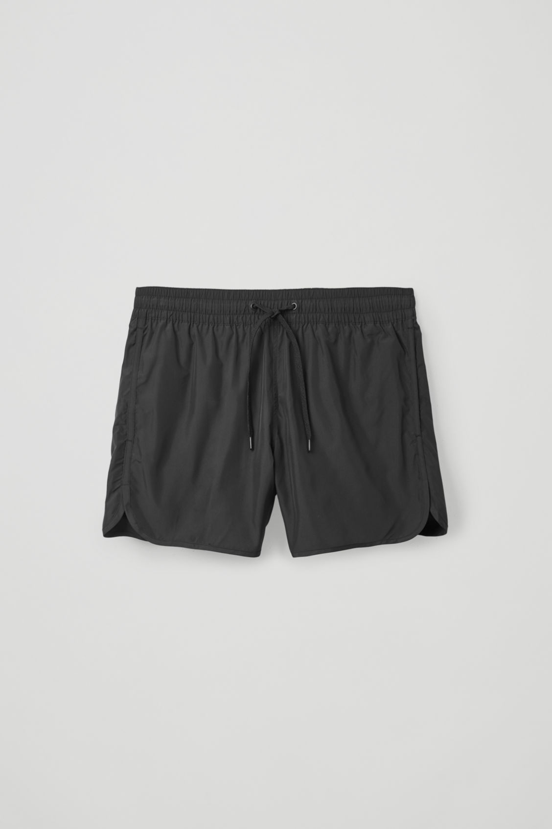 Front image of Cos swim shorts in black