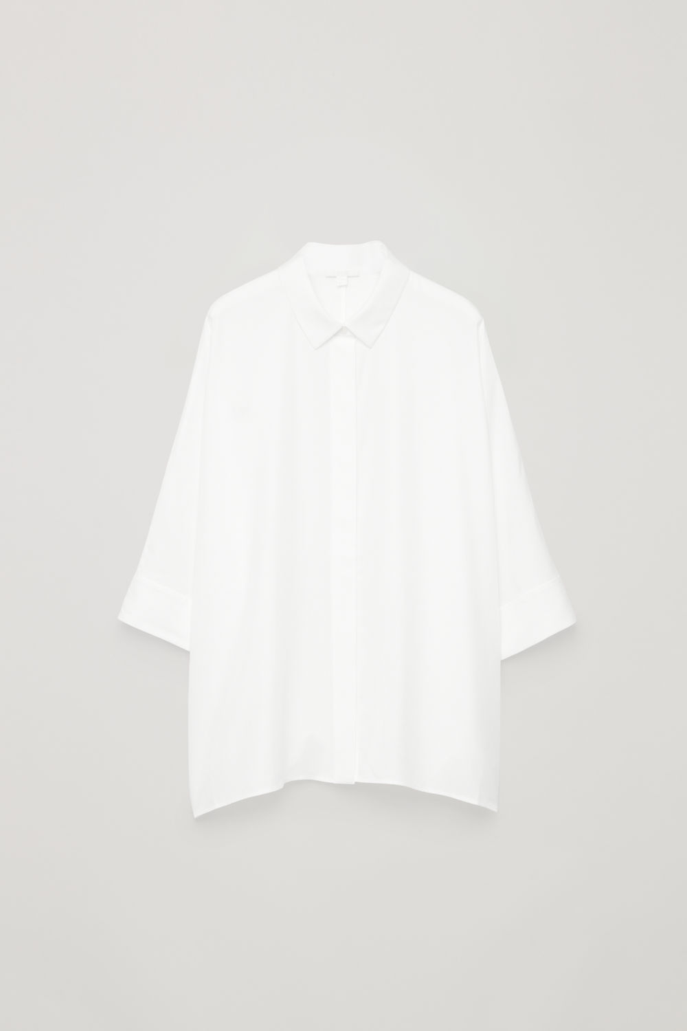 Front image of Cos draped wide-fit shirt  in white