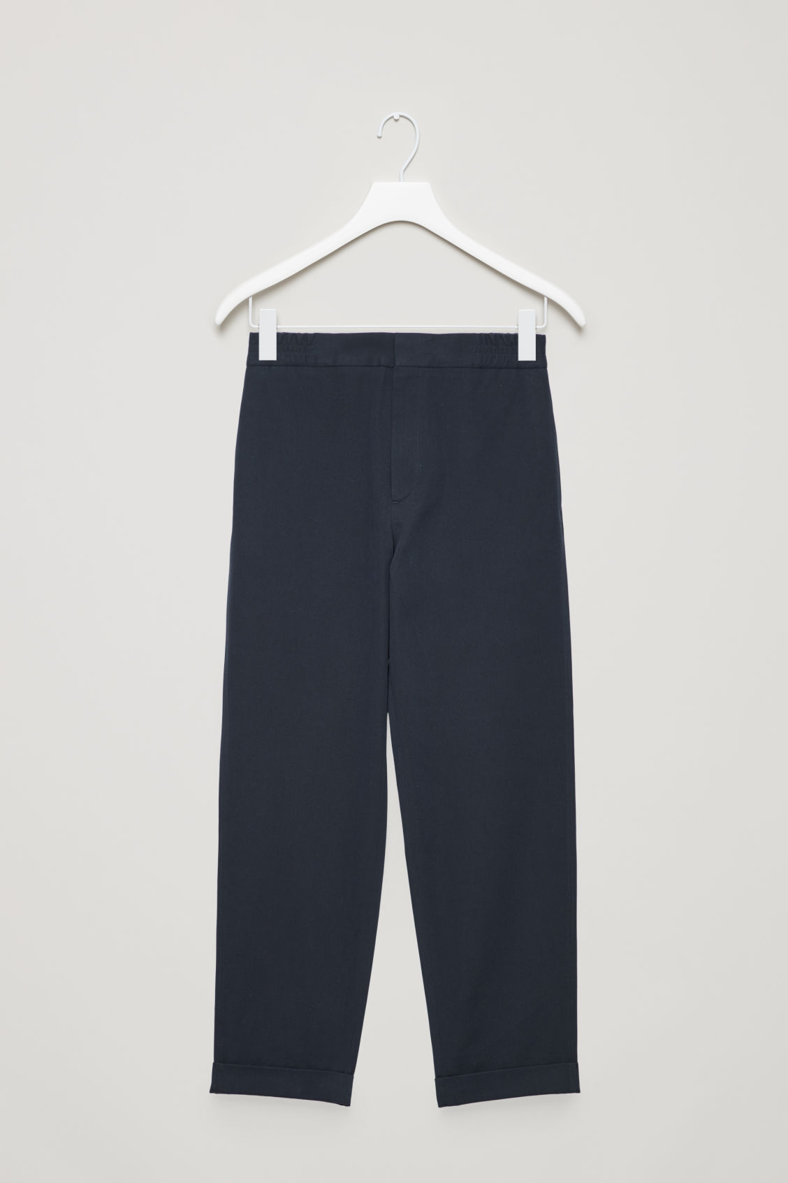 Front image of Cos tapered cotton trousers in blue