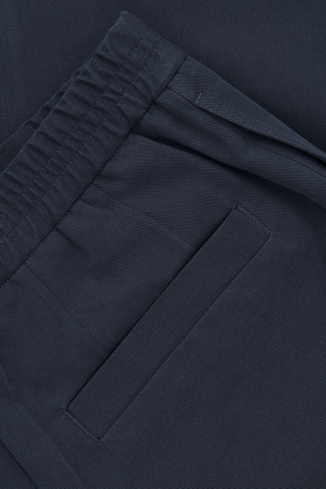 Side image of Cos tapered cotton trousers in blue