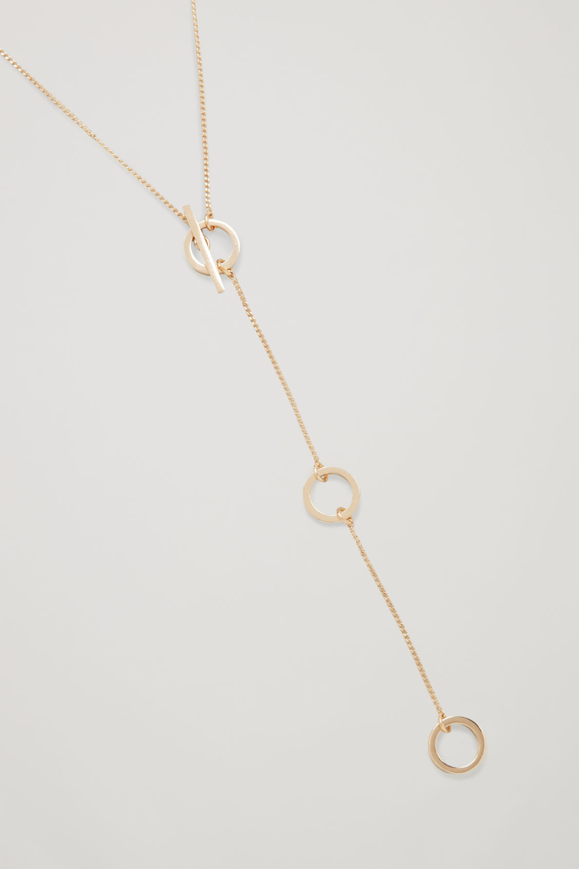 Side image of Cos adjustable ring-detail necklace  in gold