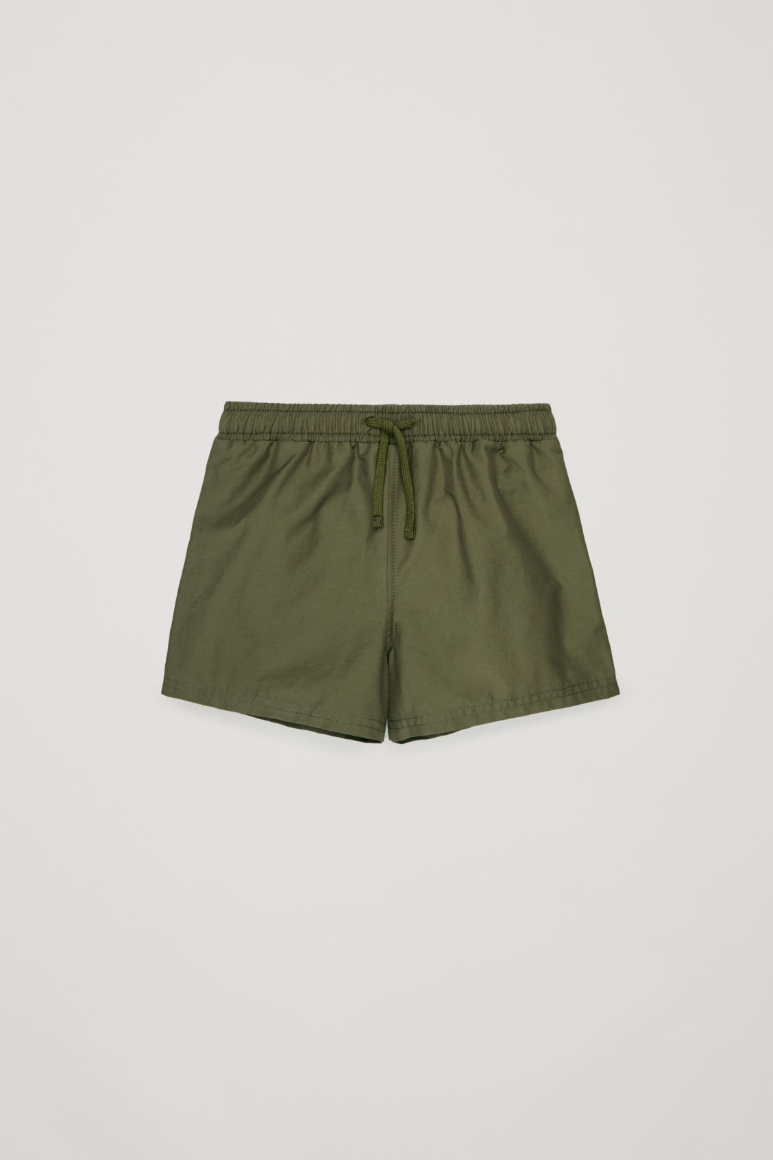 Front image of Cos swim shorts  in green