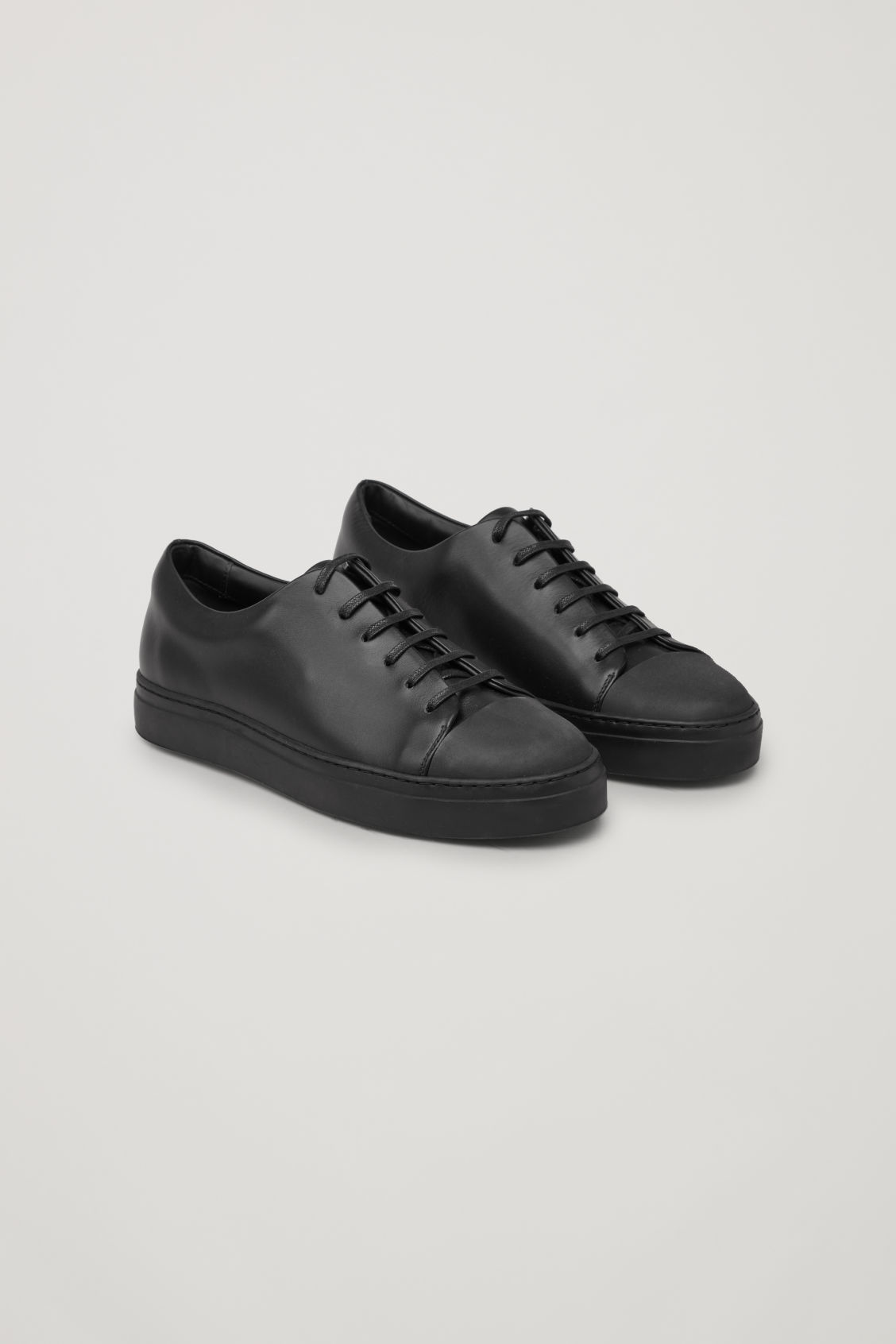 Front image of Cos  rubber-detailed leather sneakers in black