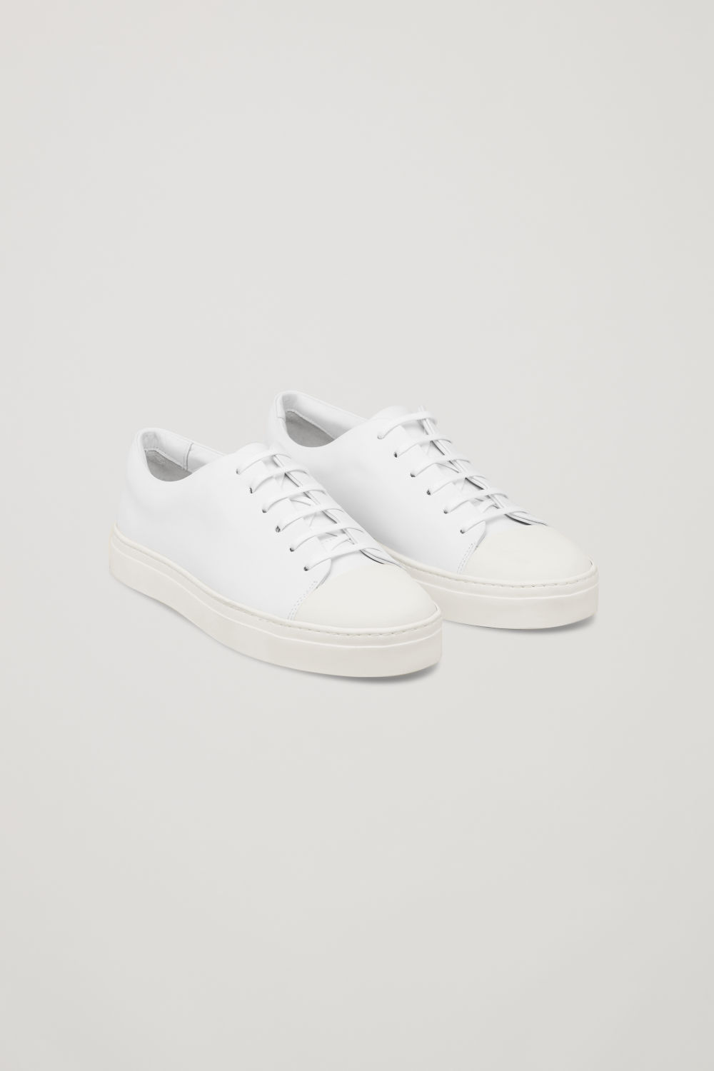 Front image of Cos  rubber-detailed leather sneakers in white