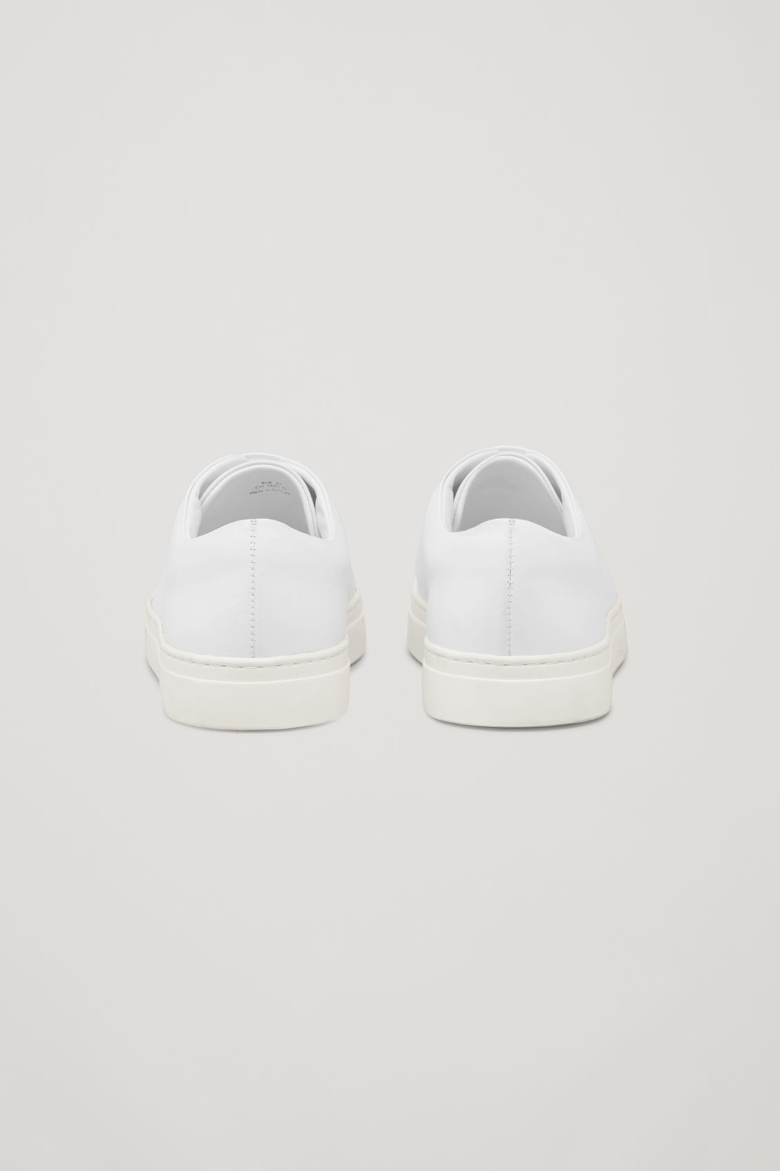 Side image of Cos  rubber-detailed leather sneakers in white