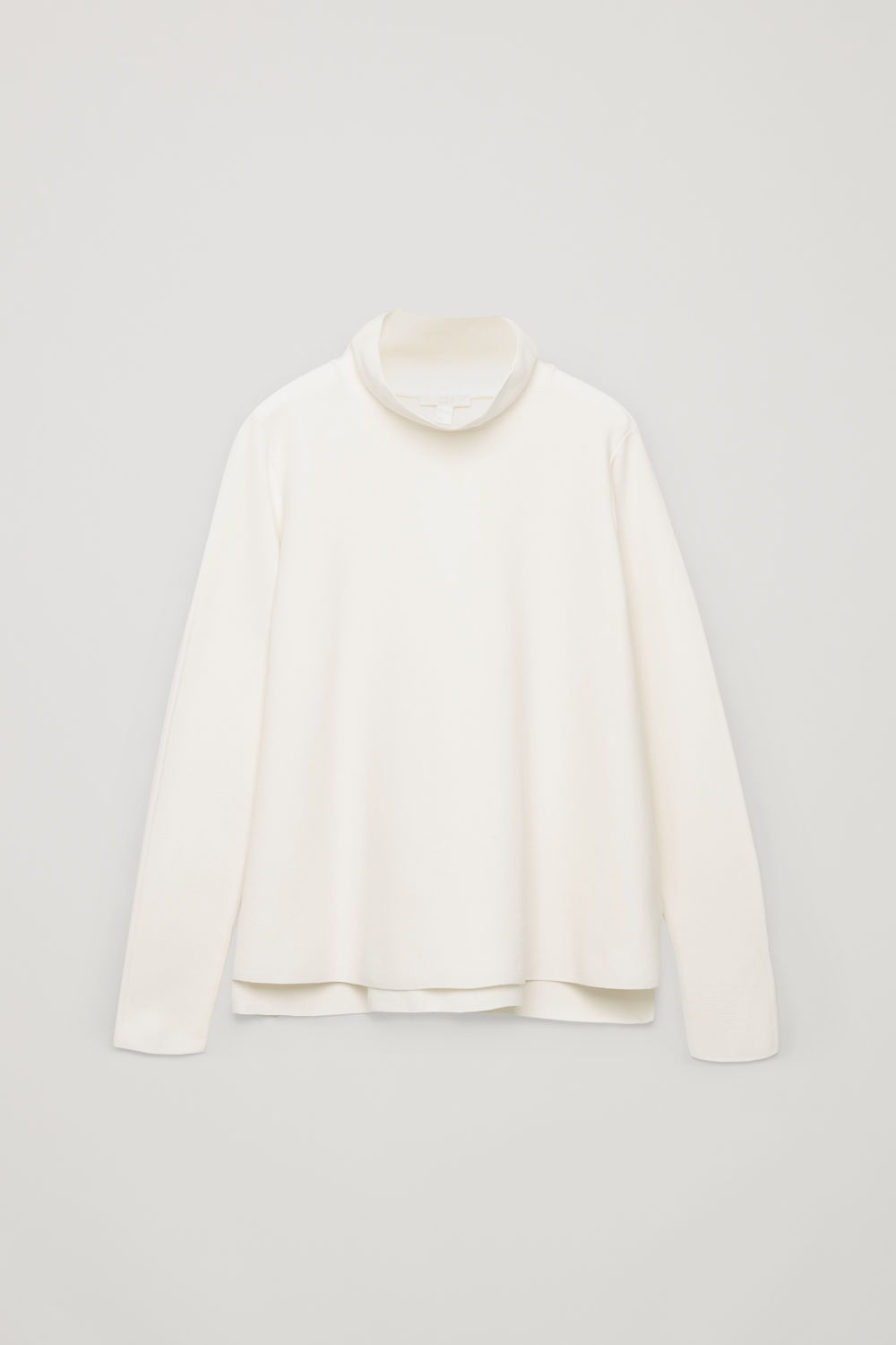 Front image of Cos high-neck a-line jumper in white