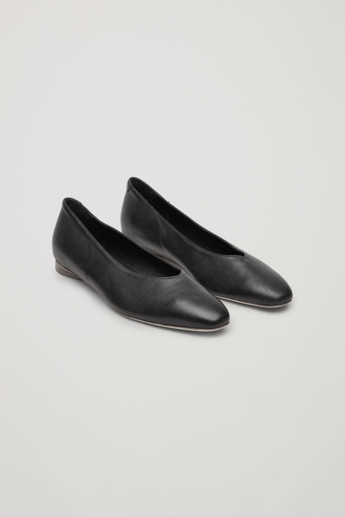 Front image of Cos leather ballerinas in black
