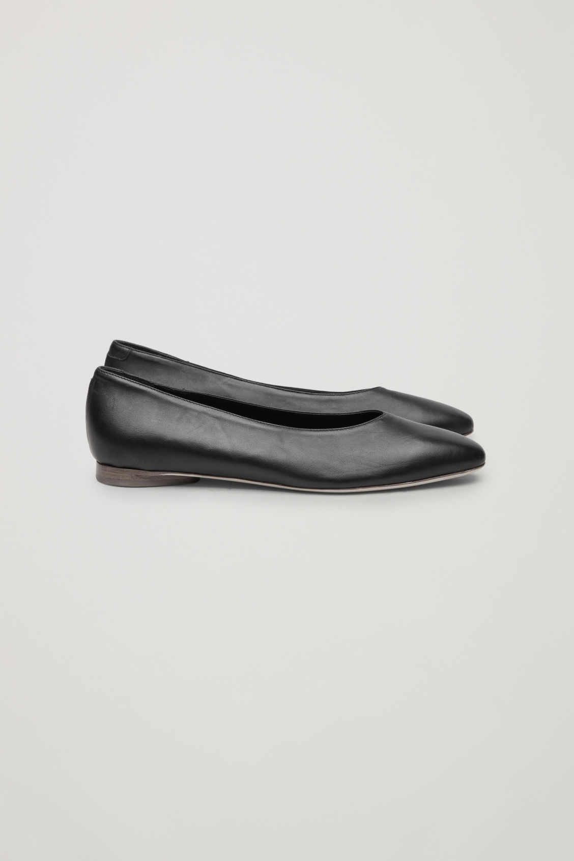 Side image of Cos leather ballerinas in black