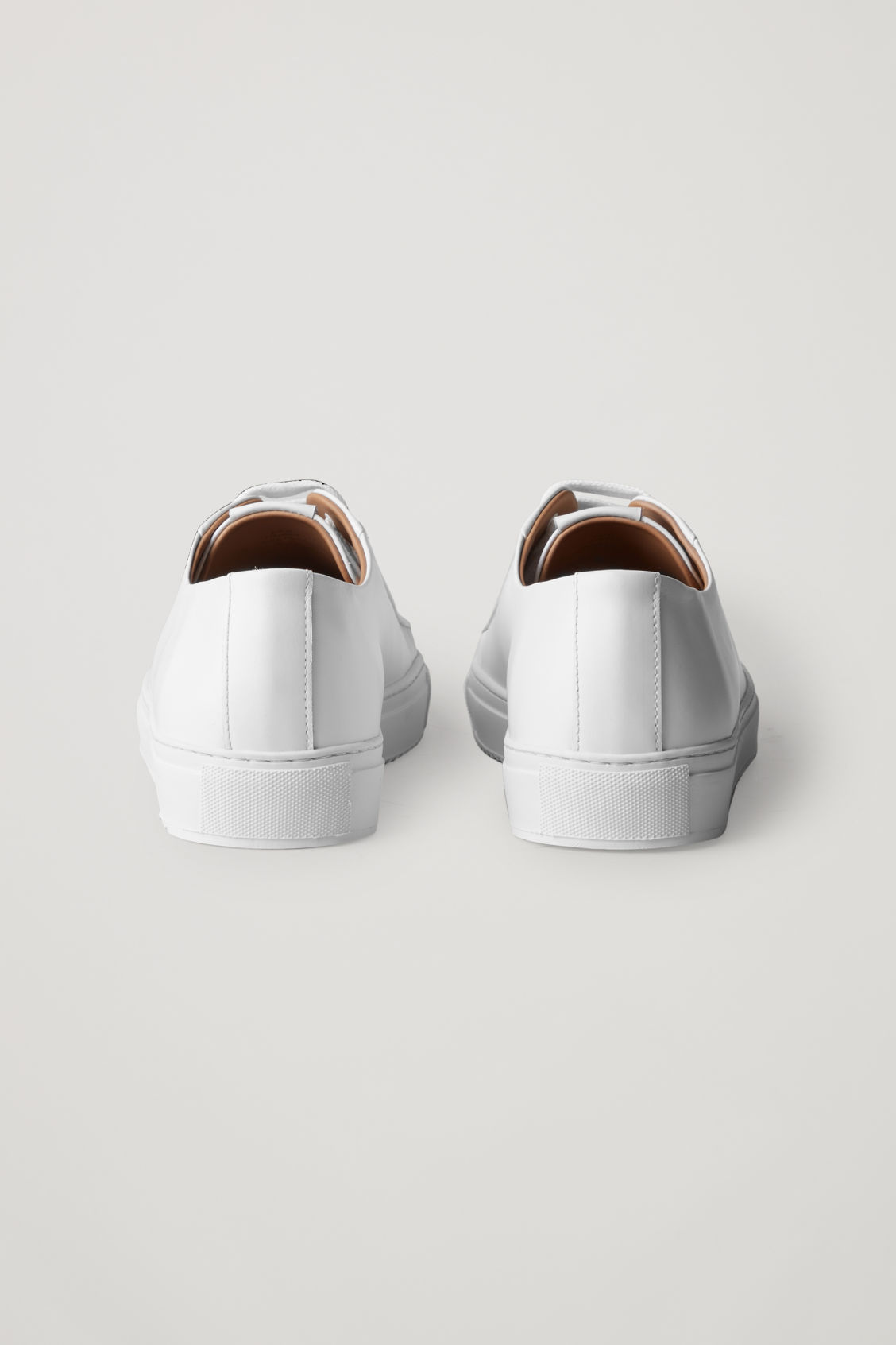 Side image of Cos thick-soled leather sneakers in white