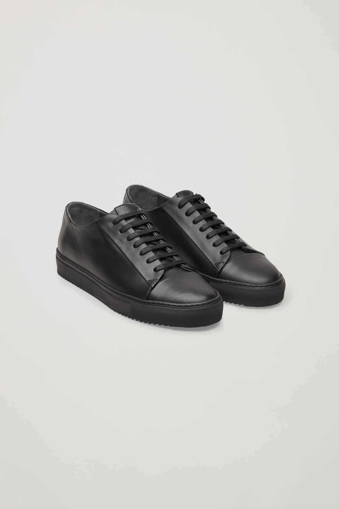 Front image of Cos thick-soled leather sneakers in black