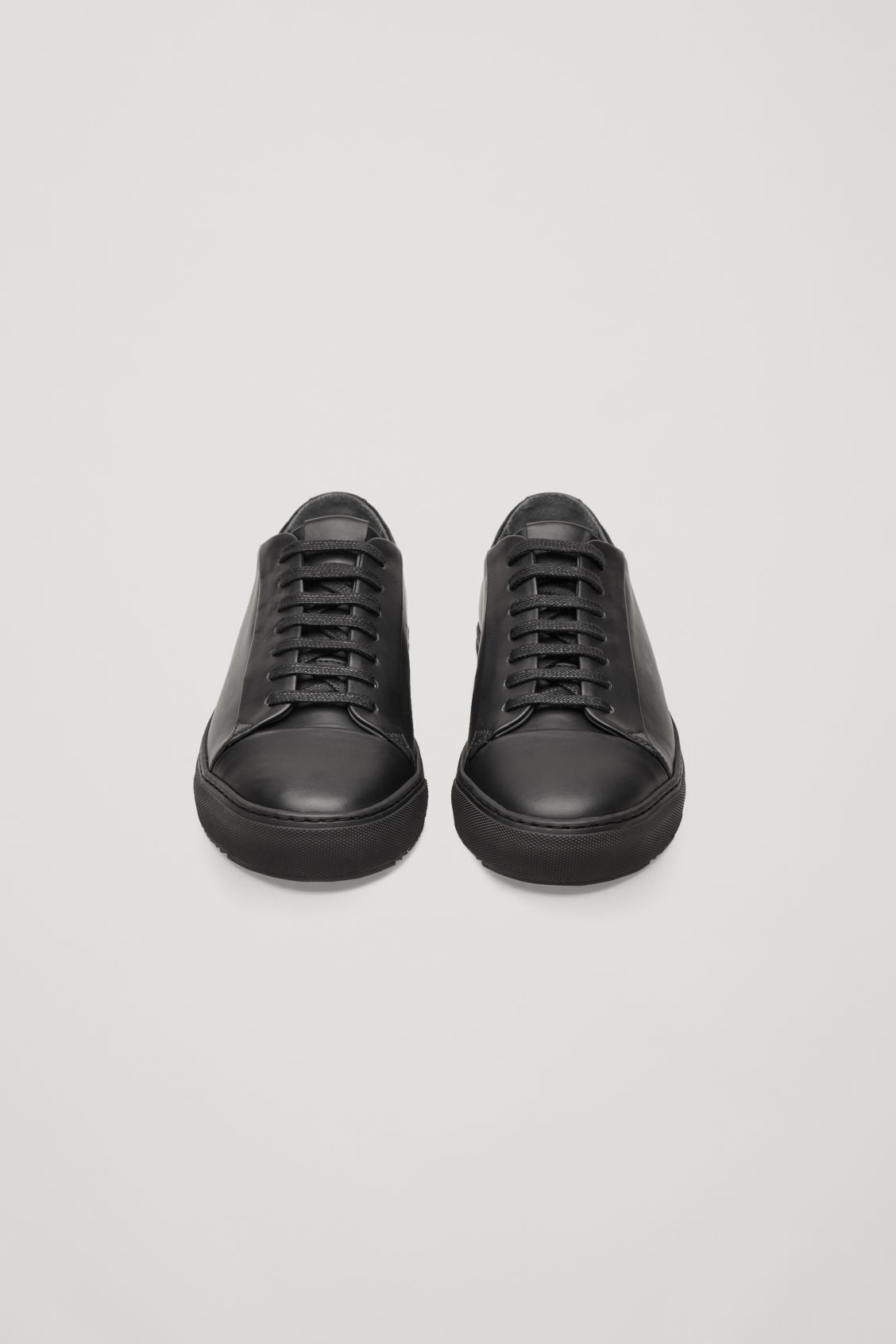 Side image of Cos thick-soled leather sneakers in black