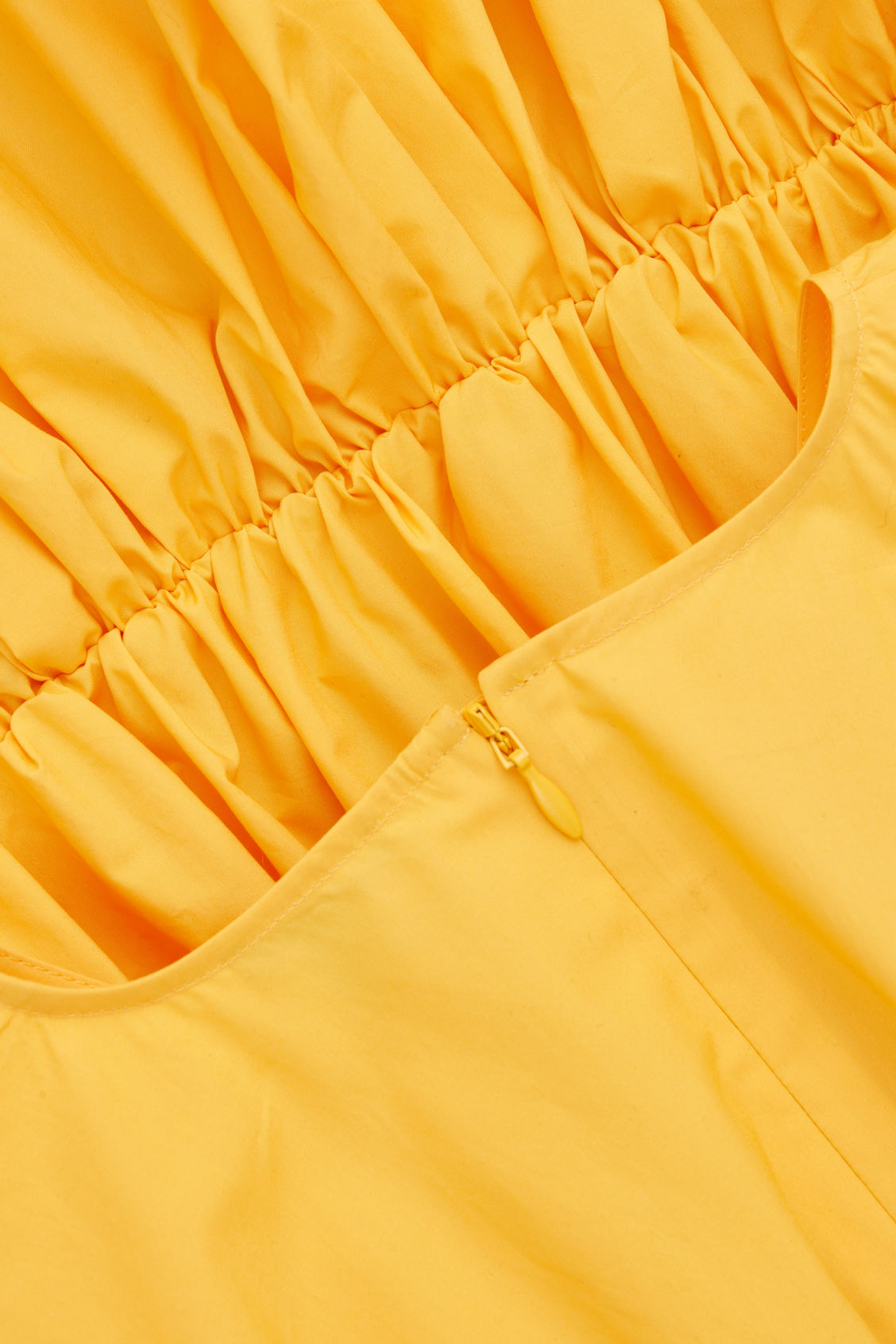 Side image of Cos null in yellow