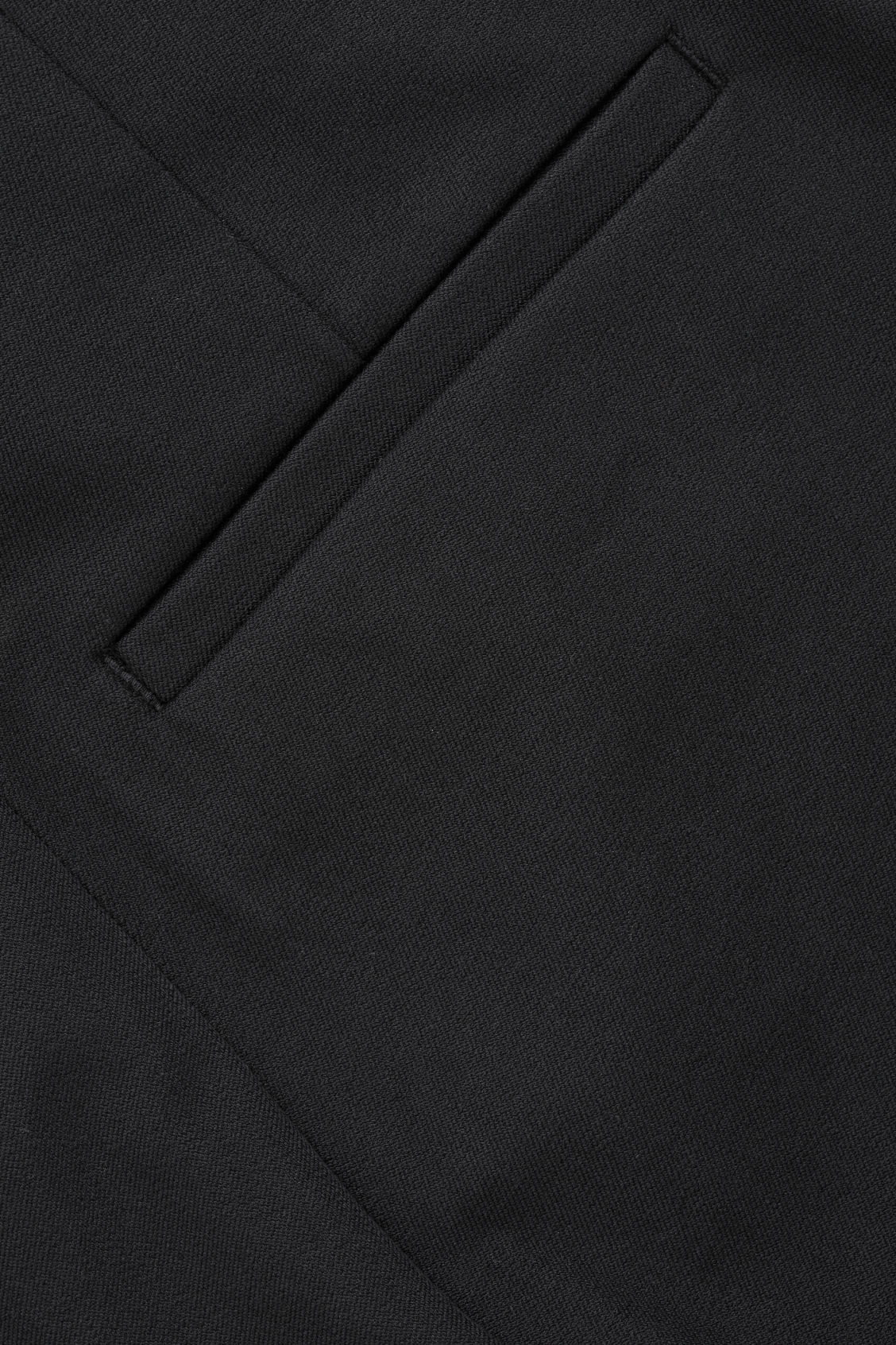 Side image of Cos trousers with ankle zips  in black