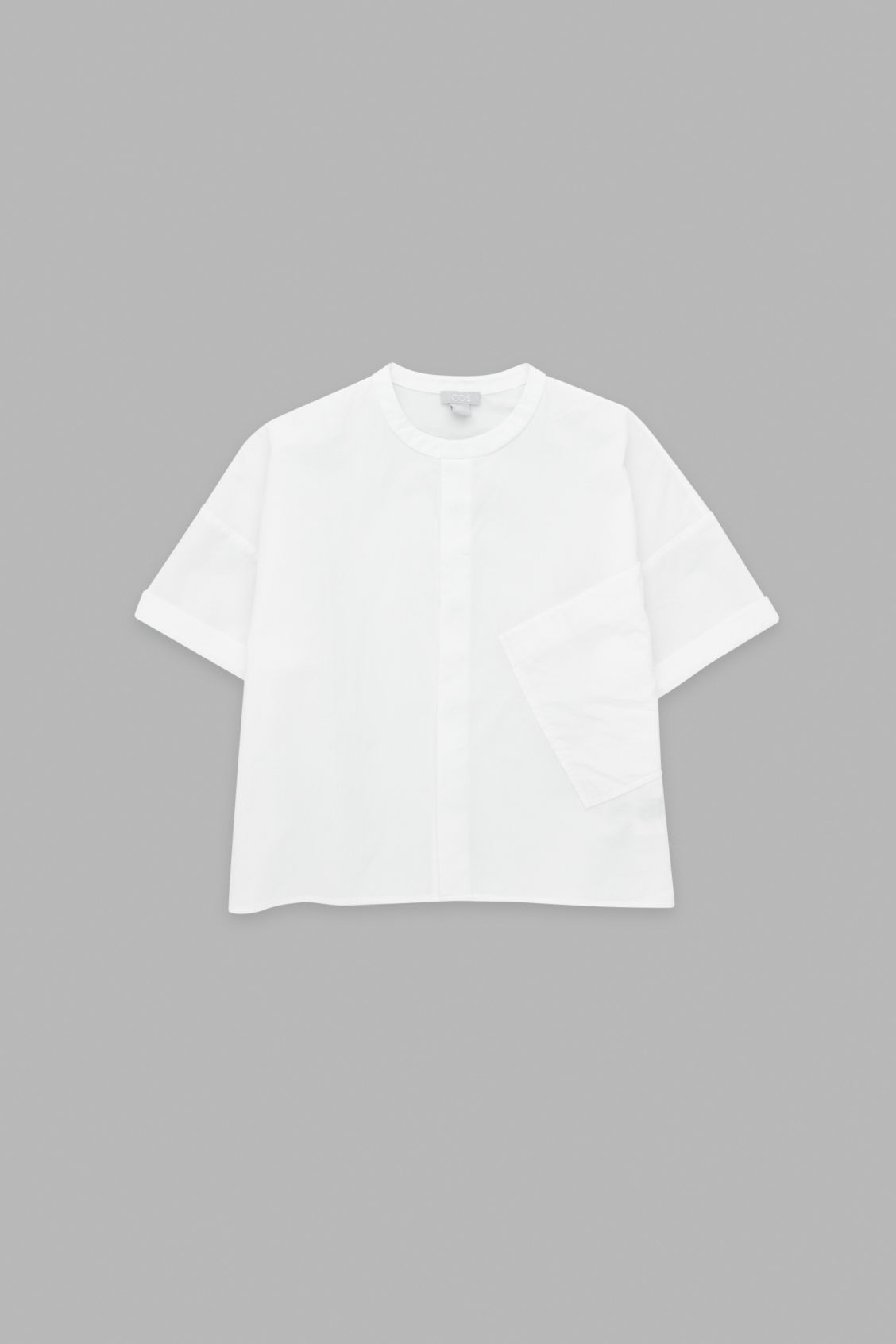 Front image of Cos shirt with standing collar in white